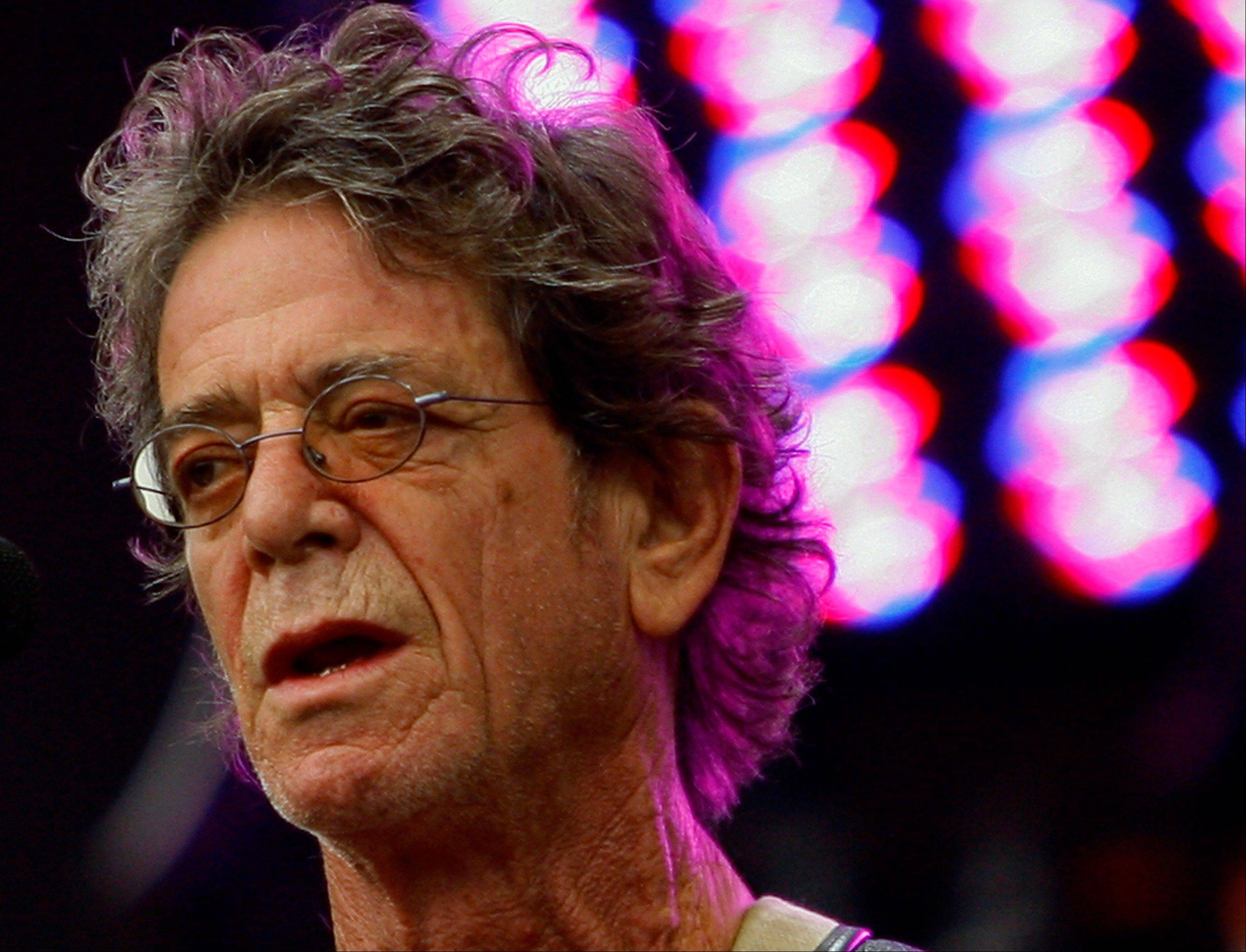 In this Sunday, Aug. 9, 2009 file photo, Lou Reed performs at the Lollapalooza music festival, in Chicago. Lou Reed�s wife says the rock icon is recovering after a life-saving liver transplant, according to an interview published Saturday, June 1, 2013, in a British newspaper. Laurie Anderson told the Times of London that Reed �was dying� before the operation in April at Ohio�s Cleveland Clinic.
