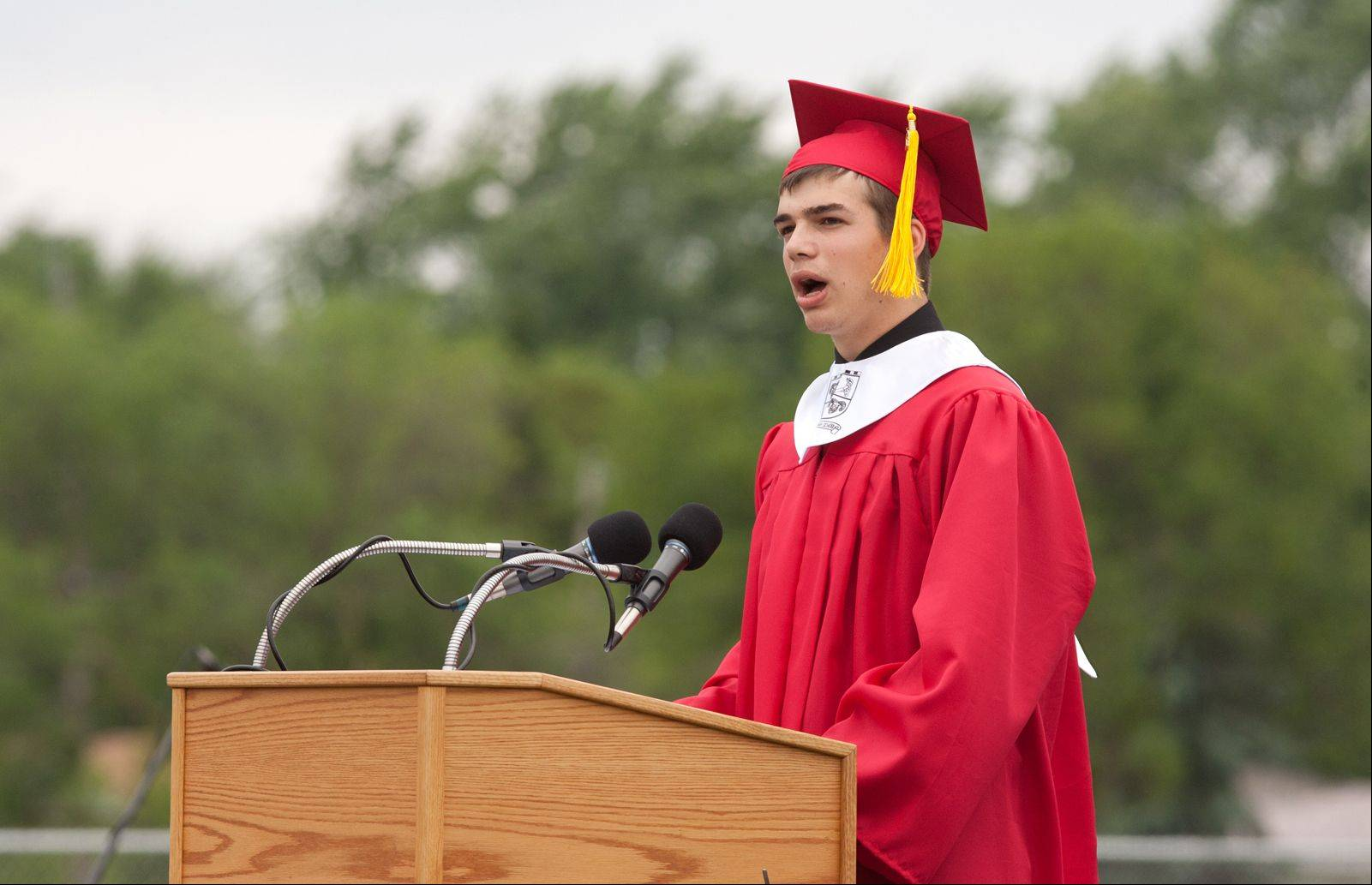 Seth Quam delivers a Message to the Class of 2013, during the Glenbard East High School graduation.
