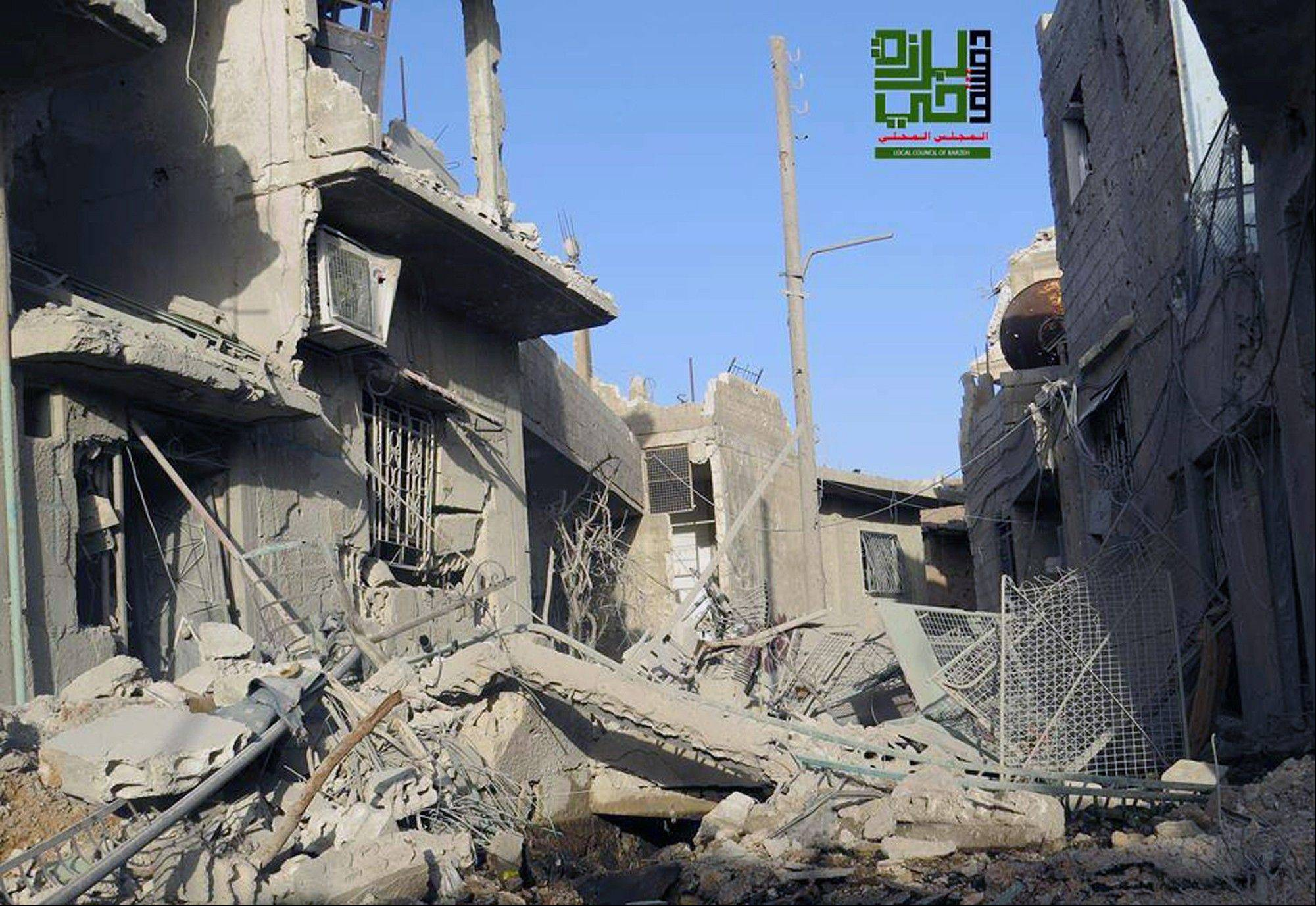 Government shelling and airstrikes have destroyed homes in the Barzeh district of Damascus, Syria.