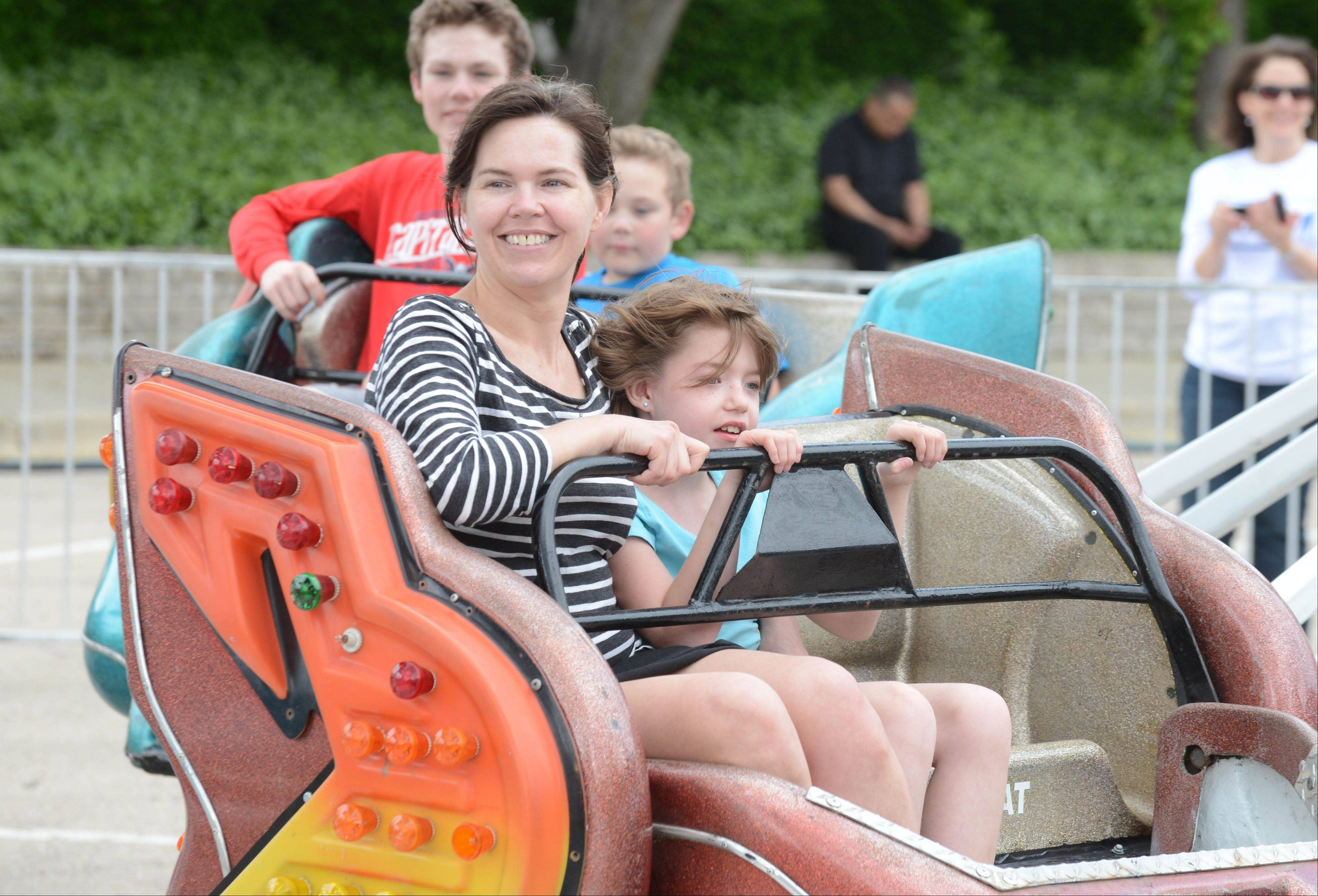 Marianna Johnson and her daughter, Ava Barton, 10, of Wheaton enjoy a ride on the �Sizzler� Saturday afternoon at the Taste of Wheaton. Food, rides, an art fair and performers were the highlights of the annual fest.