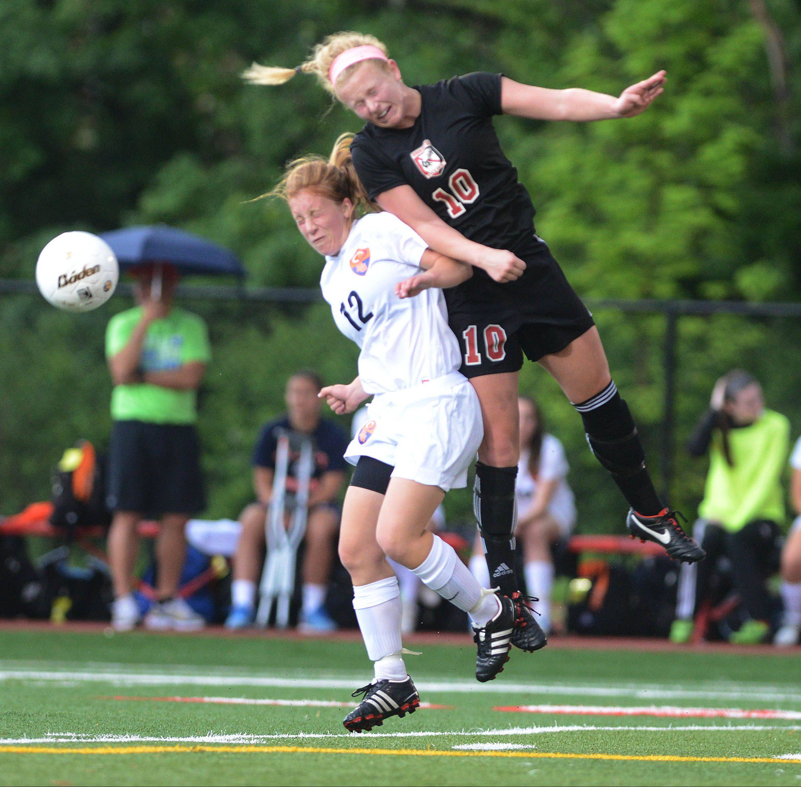 Colleen Zickert of Buffalo Grove, left, and Molly Pfeiffer of Barrington battle for possession during the girls soccer Class 3A third-place game in Naperville on Saturday.