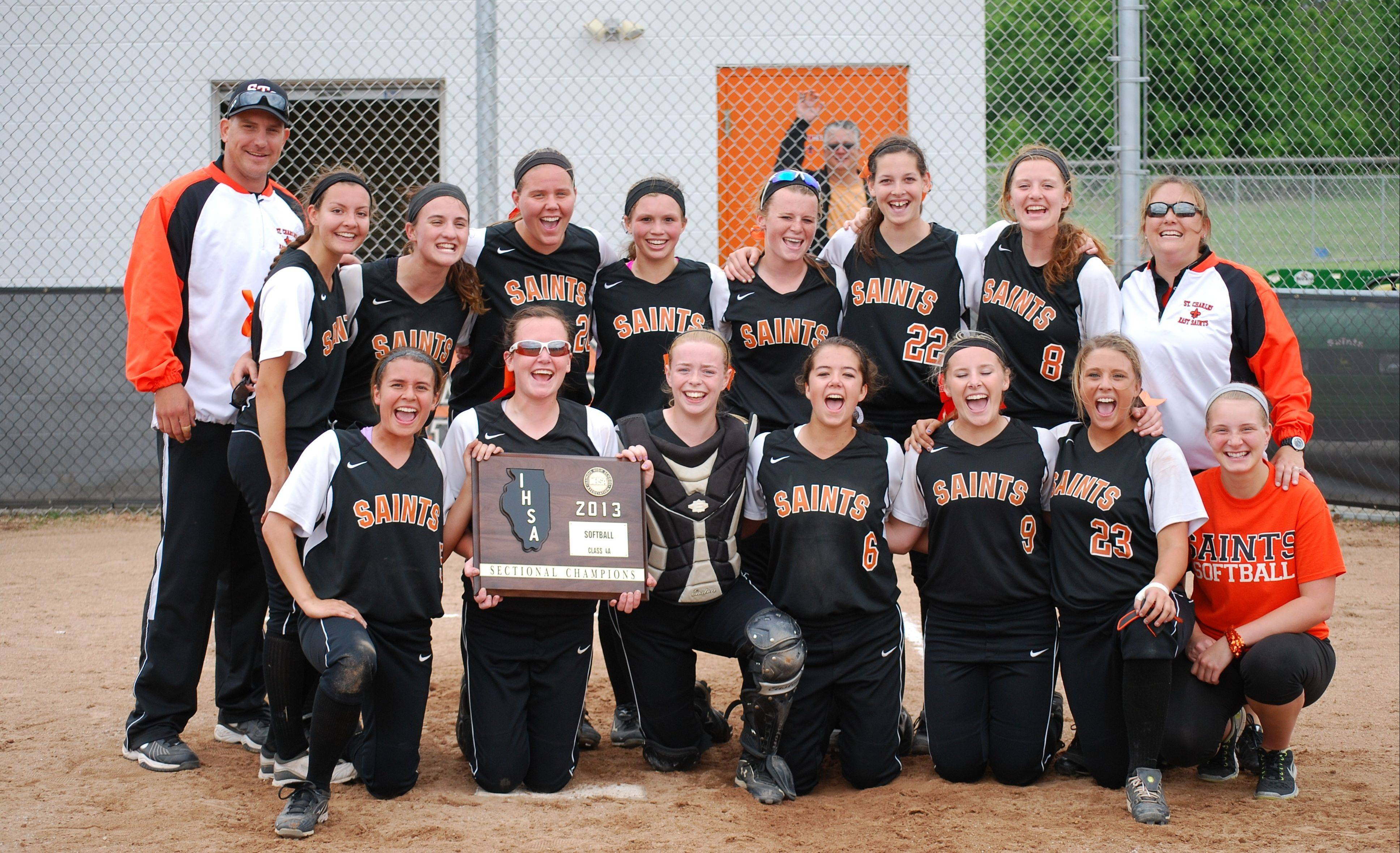 St. Charles East shows off the sectional plaque it won by beating Glenbard North Saturday.