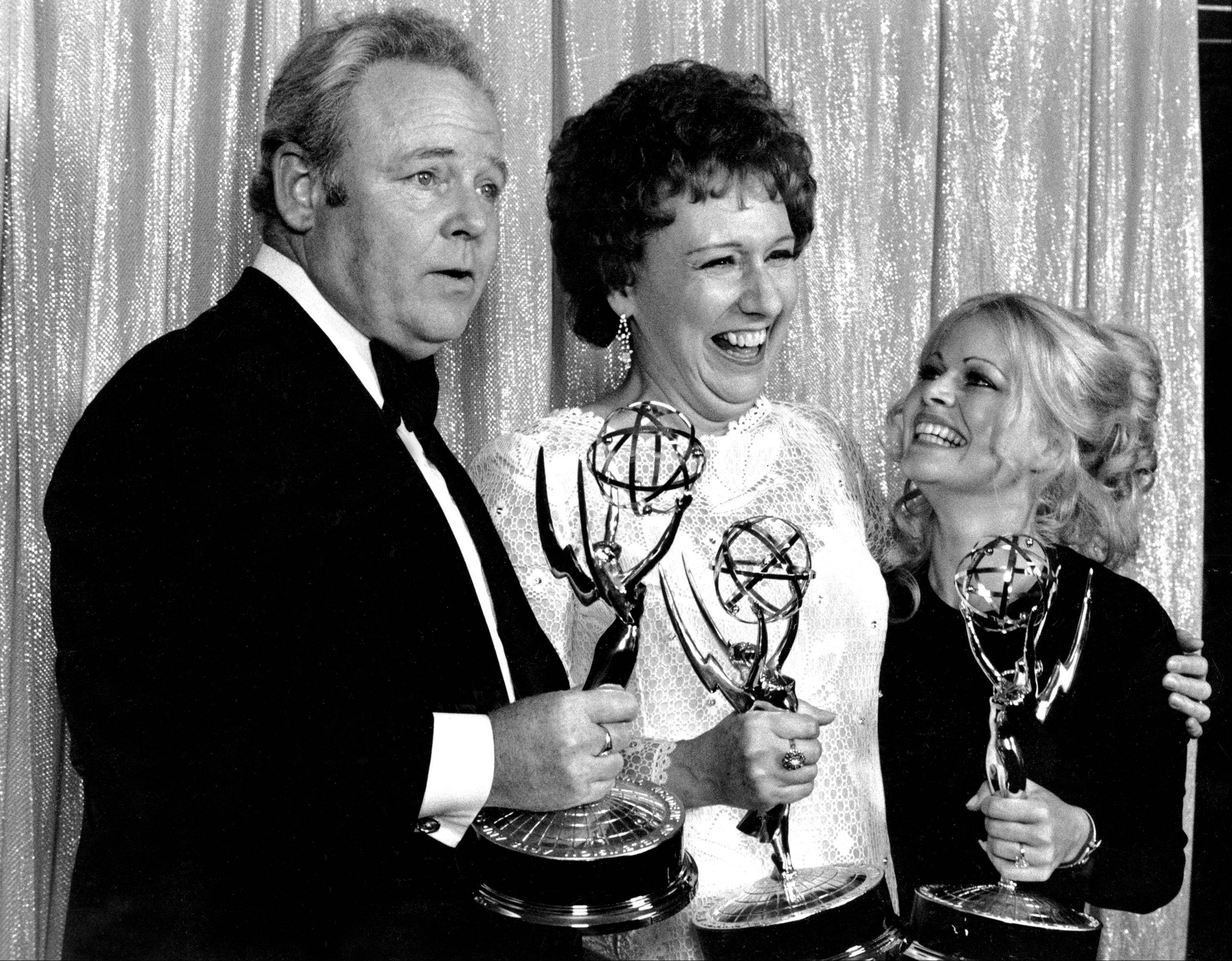"Cast members of ""All in the Family,"" from left, Carroll O'Connor, Jean Stapleton, and Sally Struthers pose with their Emmys backstage at the 24th annual Emmy Awards in Hollywood, Ca., Sunday night, May 14, 1972. O'Connor and Stapleton won outstanding continued performance by an actor and actress in a leading role in a comedy series. Struthers tied in the category of outstanding performance by an actress in a supporting role in a comedy. Stapleton has died at the age of 90. John Putch said Saturday, June 1, 2013 that his mother died Friday, May 31, 2013 of natural causes at her New York City home surrounded by friends and family."