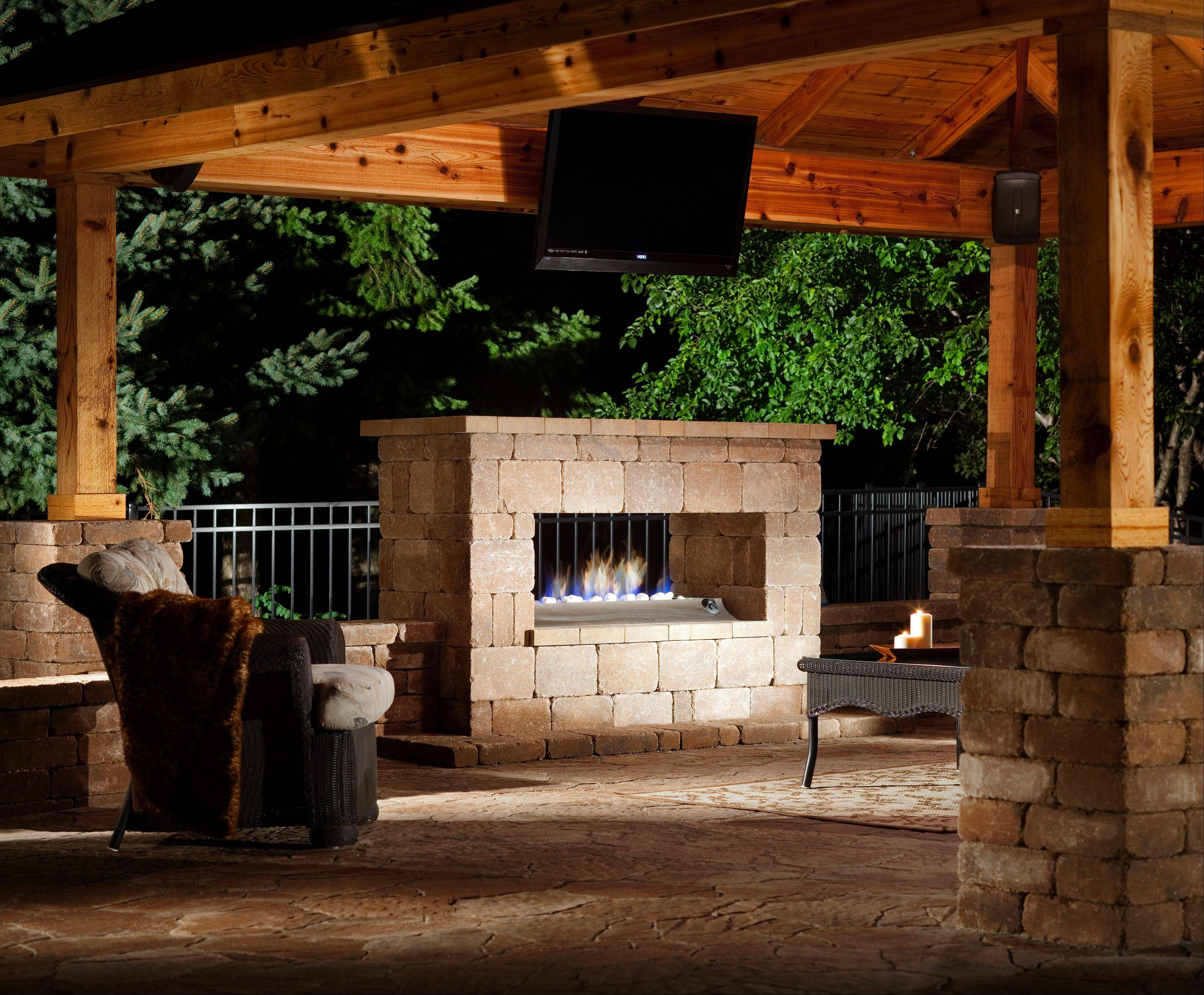 People living in the Midwest spend more on their outdoor living spaces, studies have found. This outdoor fireplace was made using paver blocks by Belgard Hardscapes.