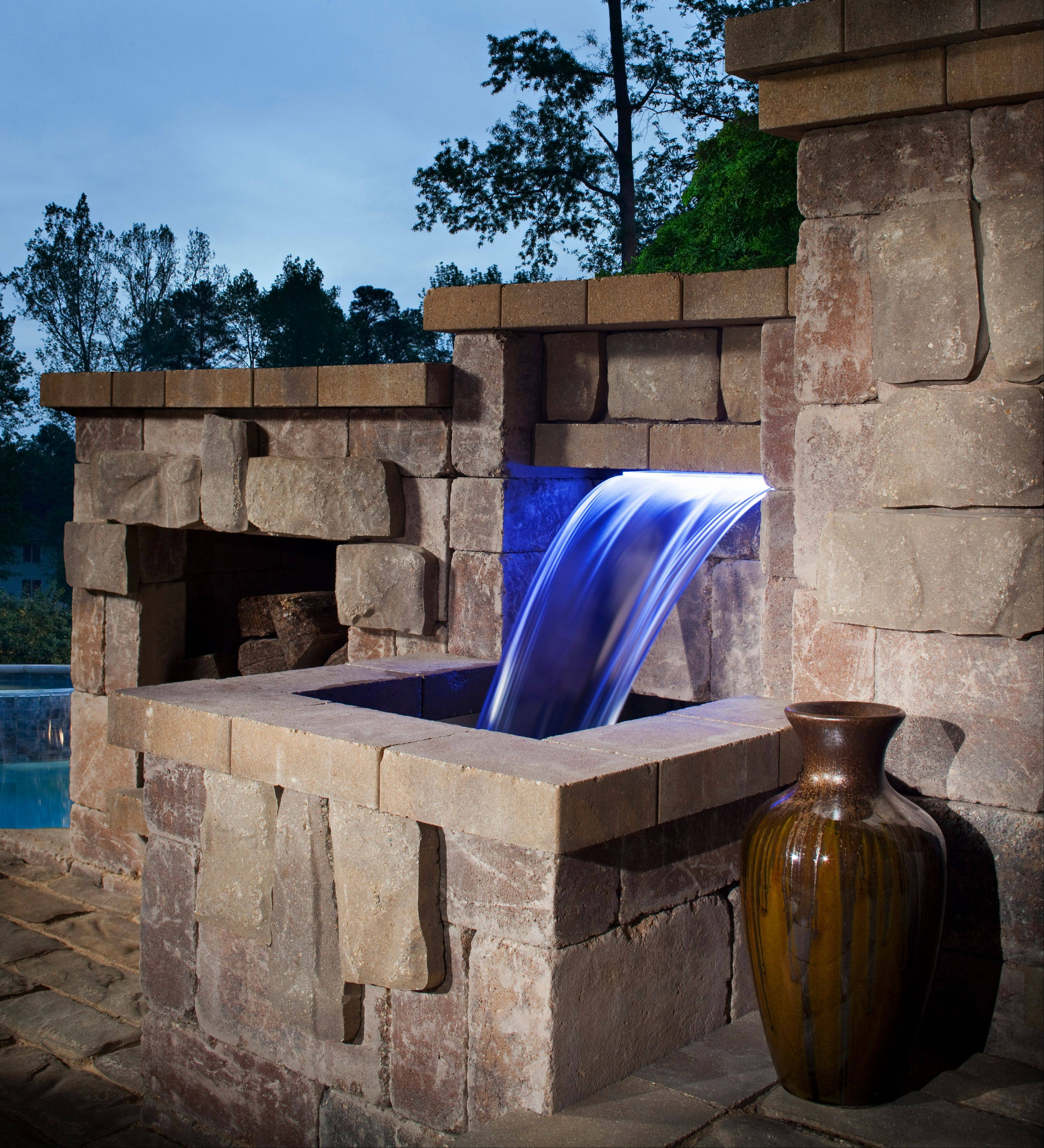 This lighted waterfall is part of a patio feature made using Belgard blocks and pavers.