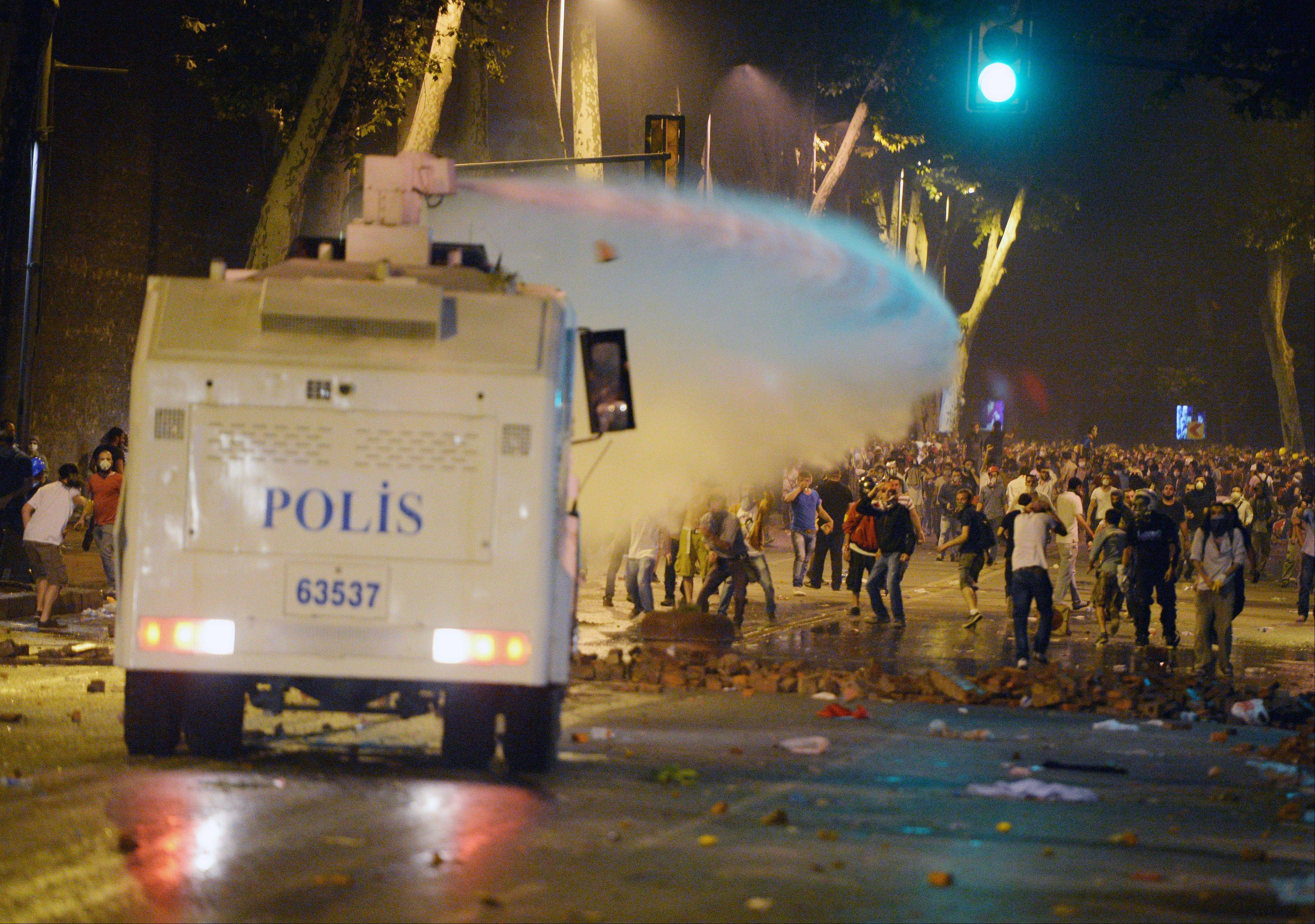Turkish police retreated from a main Istanbul square Saturday, removing barricades and allowing in thousands of protesters in a move to calm tensions after furious anti-government protests turned the city center into a battlefield.