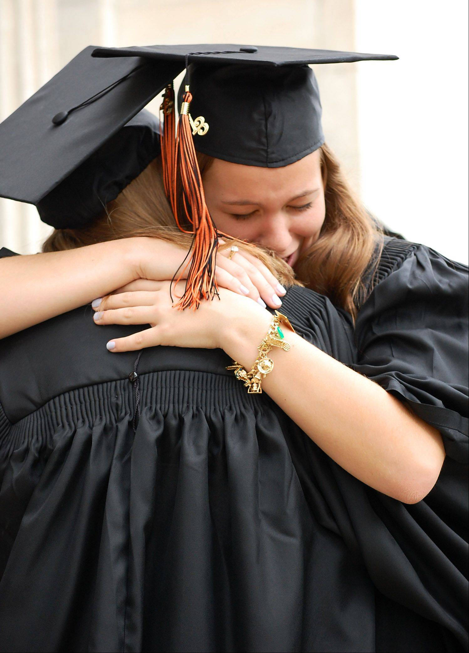 Graduates Shayna Oriold of St. Charles and Sedona Georgescu of Barrington embrace before the Elgin Academy High School graduation ceremony Saturday, June 1st at Elgin Academy in Elgin.