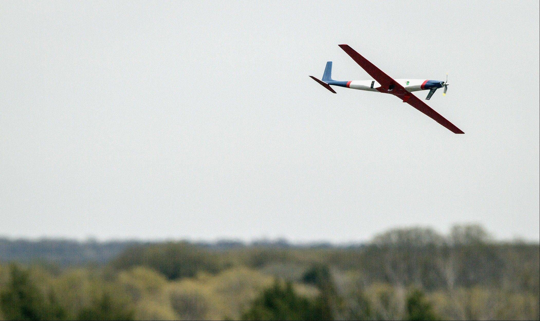 Team Black's airplane takes off during SpeedFest III, in Stillwater, Okla. Researchers at Oklahoma State University are designing and building sleek, Kevlar-reinforced unmanned aircraft to fly into the nation's worst storms.