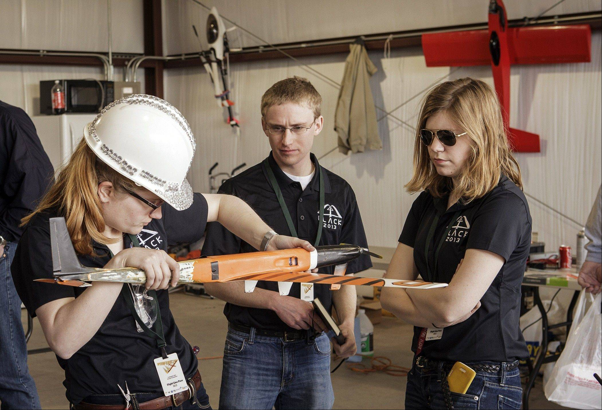 Team Black members from left, Amelia Wilson, Nathan Woody and Alyssa Avery prepare their aircraft for flight during SpeedFest III at Oklahoma State University, in Stillwater, Okla.