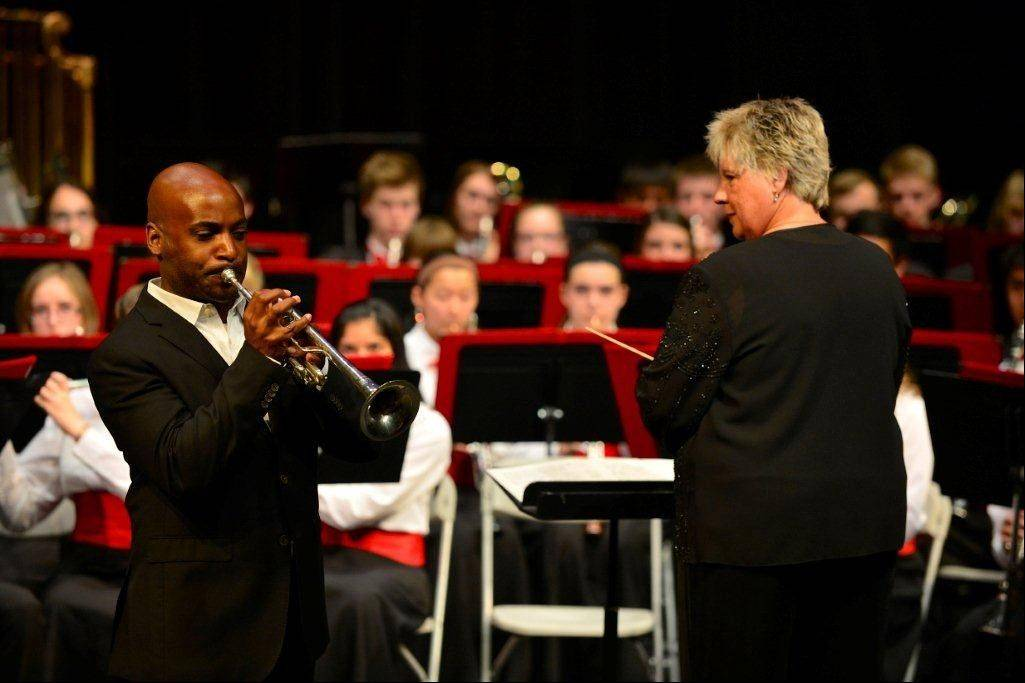 Palatine High School band director Raeleen Horn conducts next to guest performer Tage Larsen from the Chicago Symphony Orchestra.