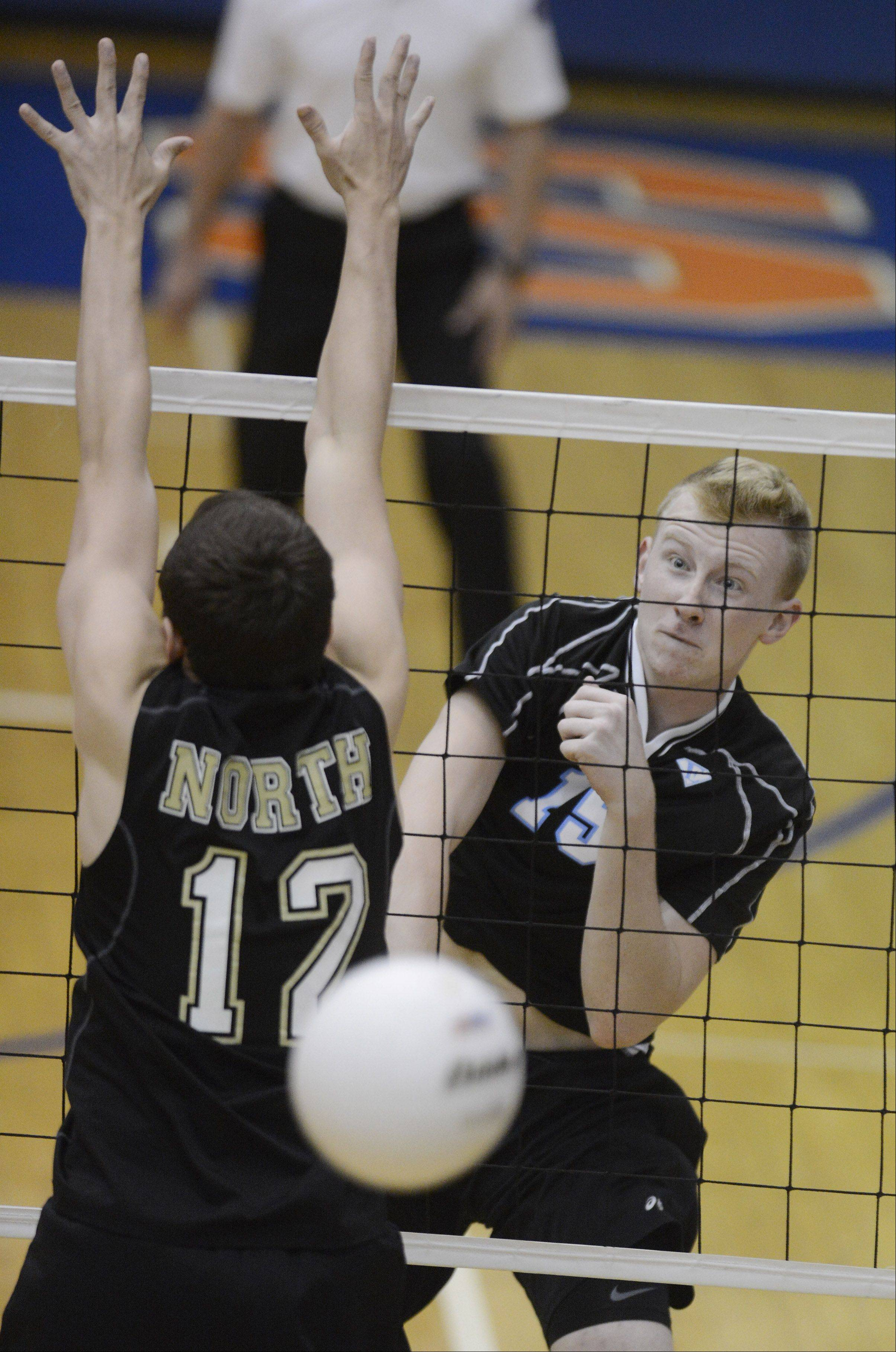 Mike Schmitt of Downers Grove South gets a kill during the state-championship game against Lincoln Way North at Hoffman Estates High School Saturday.