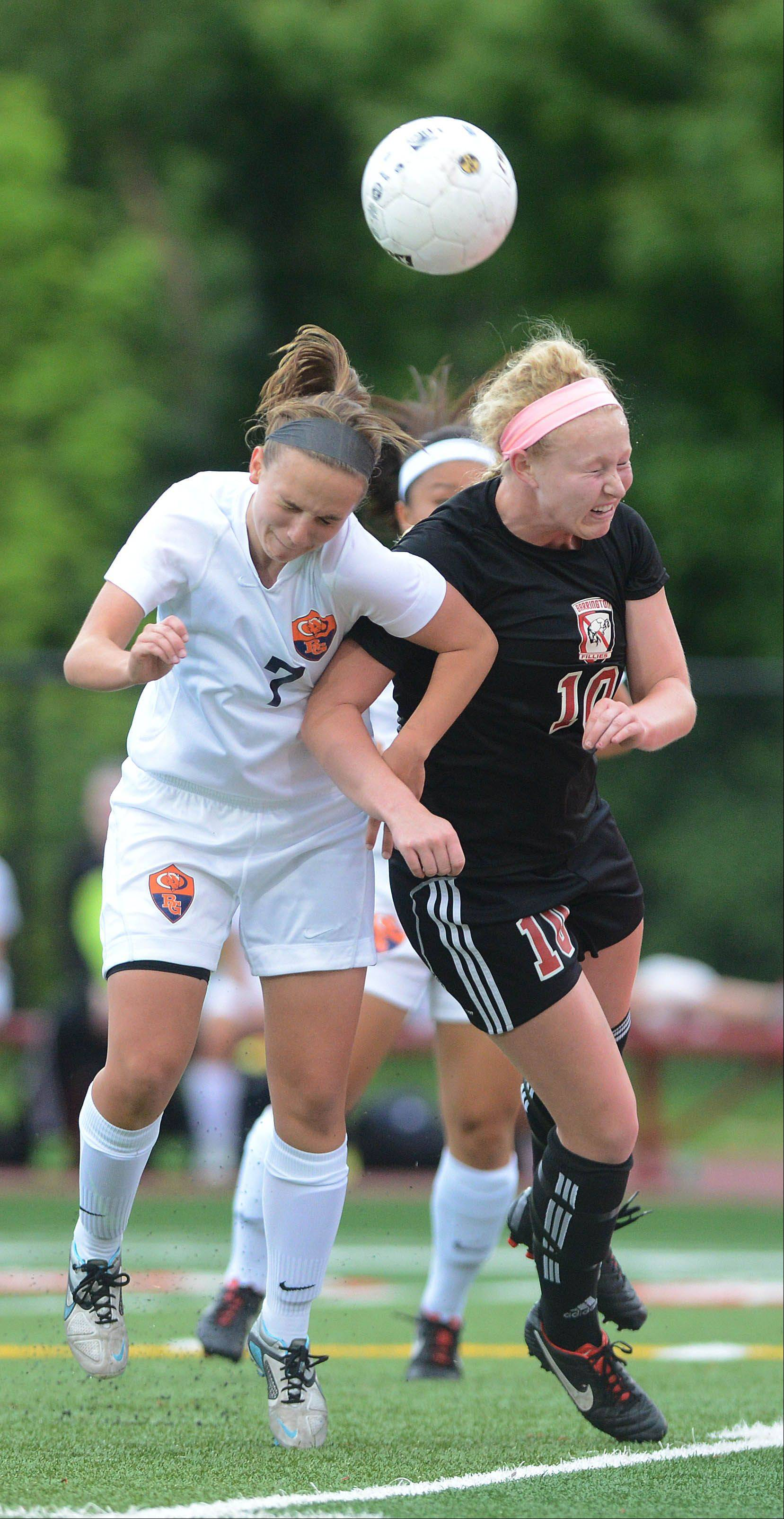 Jessica Kovach of Buffalo Grove, left, and Molly Pfeiffer of Barrington, fight for the ball during the Class 3A third-place match game Saturday.