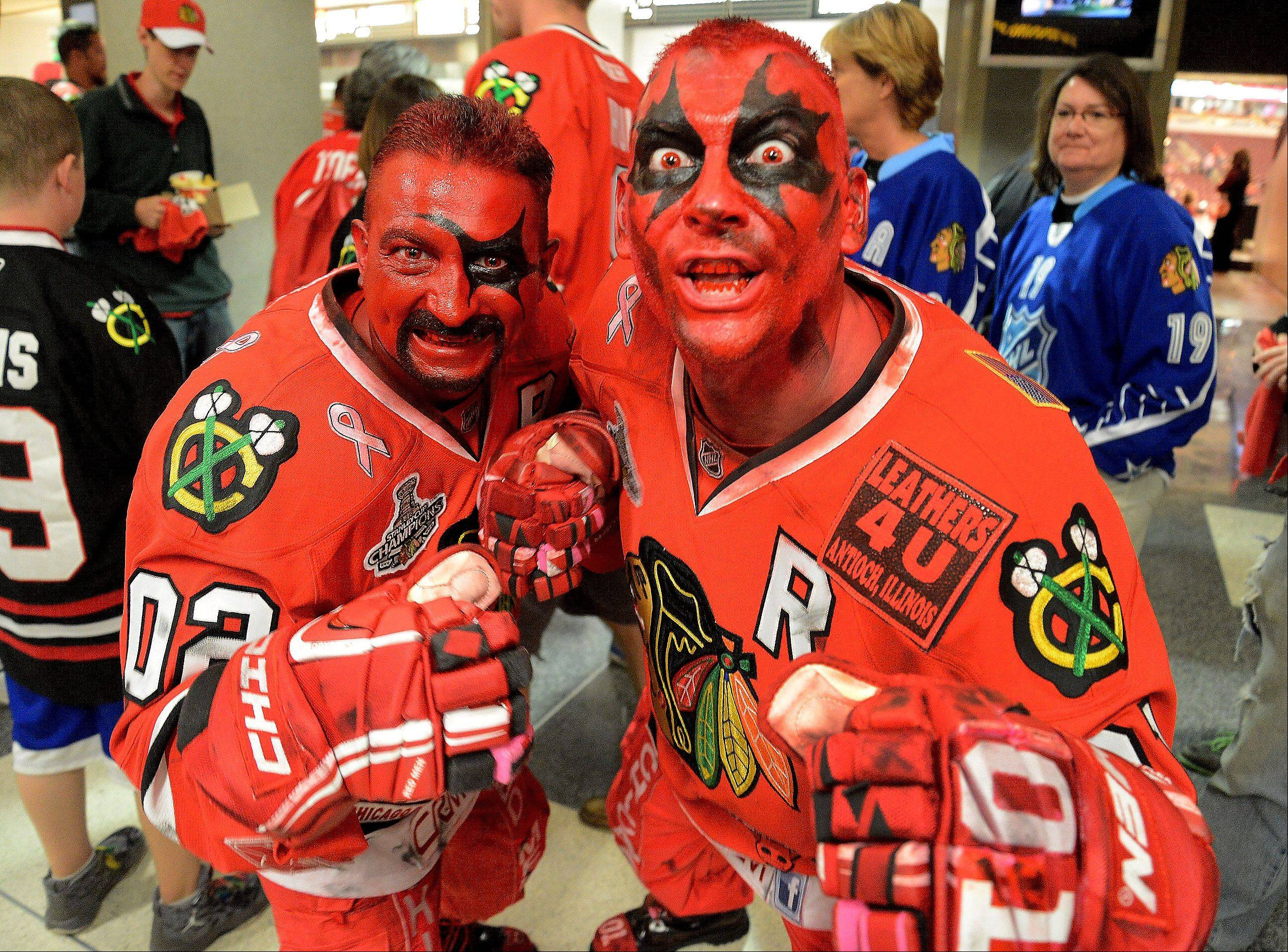 Dominic Randazzo, left, and Dan Raciak, both from Ingleside, who call themselves the Chicago Red Men, get pumped-up for game 1 of the Western Conference finals between the Chicago Blackhawks and the Los Angeles Kings.