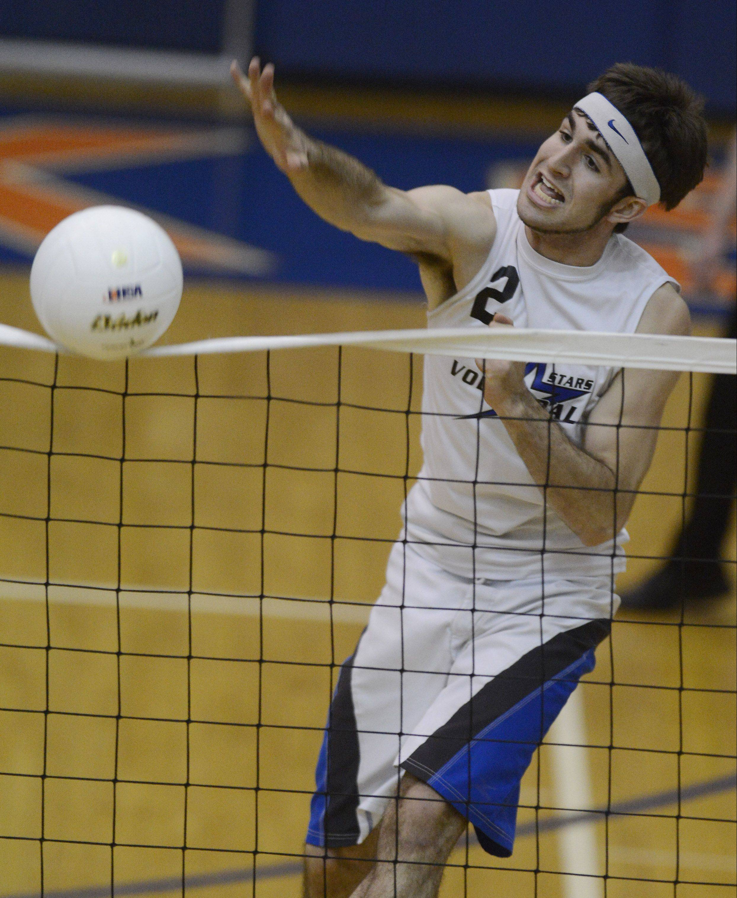 The ball just clears the net as St. Charles North Jonathan Orech gets a kill Saturday against Glenbrook South.
