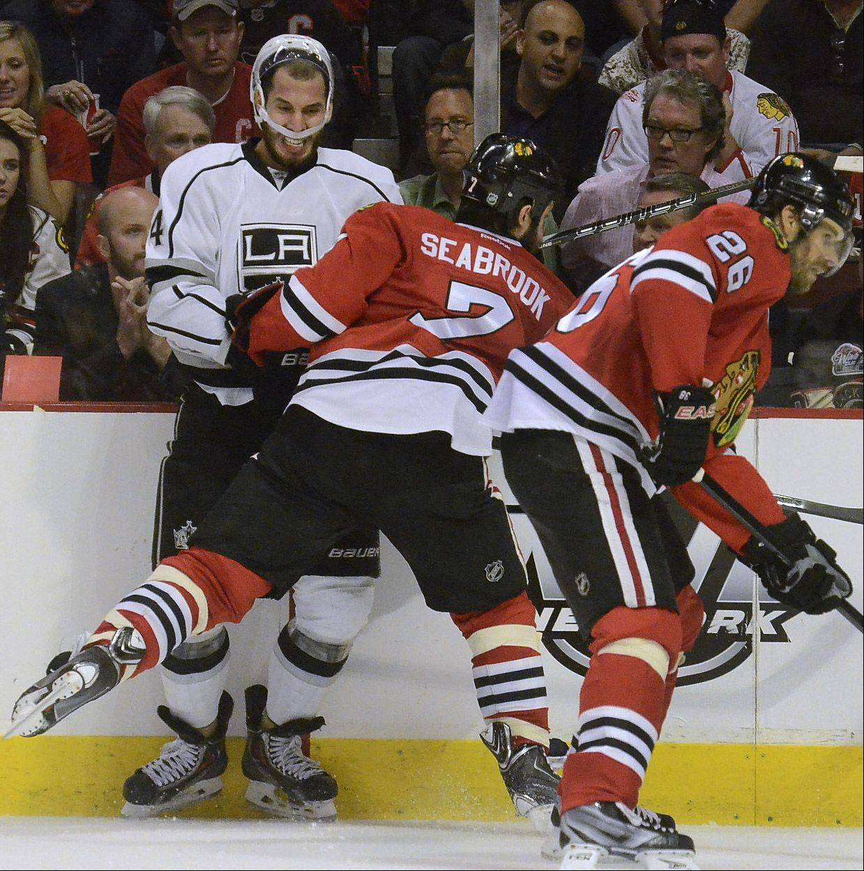 The Kings Dwight King gets nailed by Brent Seabrook in second-period action in Game 1 of the Western Conference finals between the Chicago Blackhawks and the Los Angeles Kings.