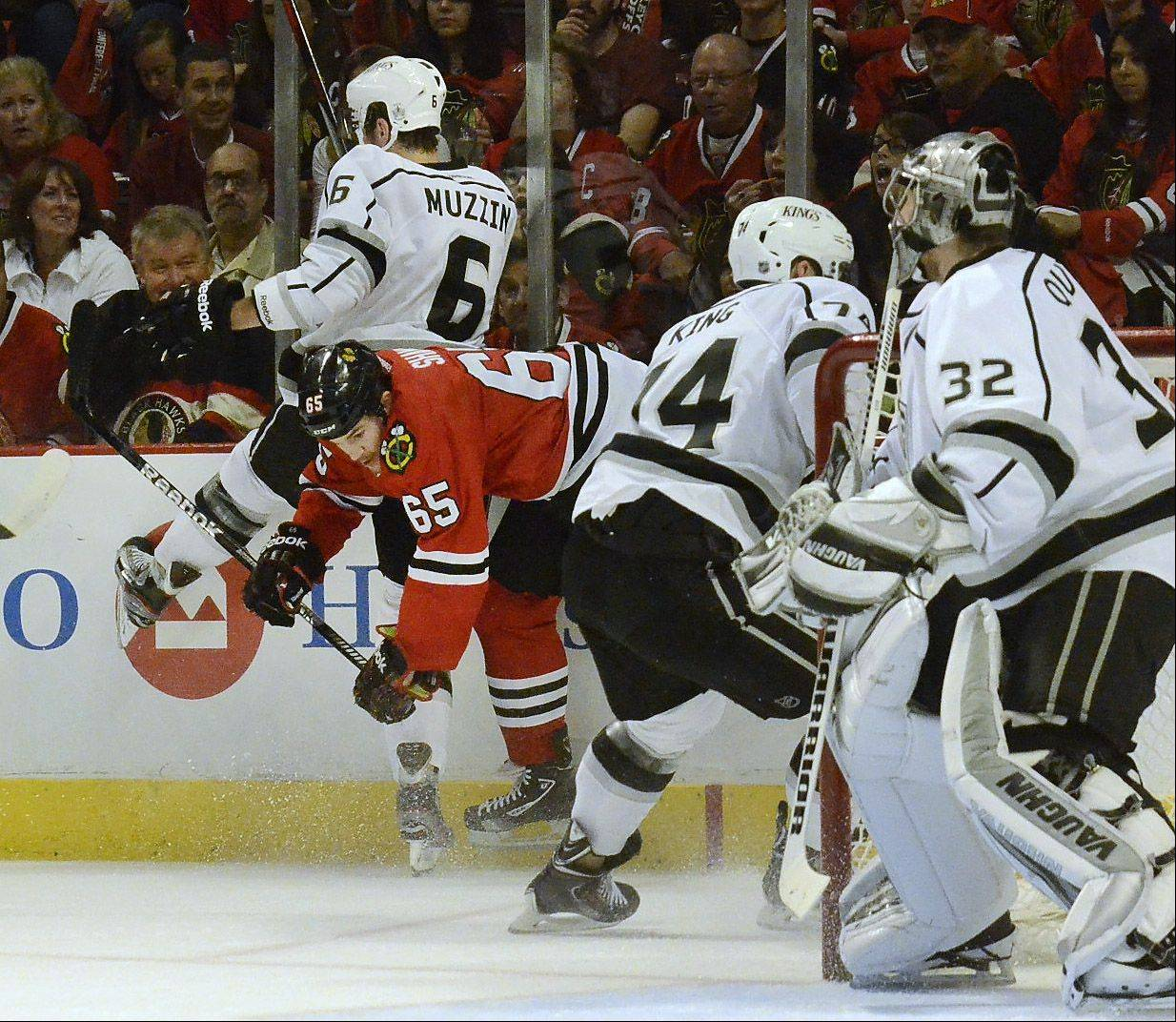 Andrew Shaw hits the Kings Jake Muzzin in first-period action in Game 1of the Western Conference finals between the Chicago Blackhawks and the Los Angeles Kings.