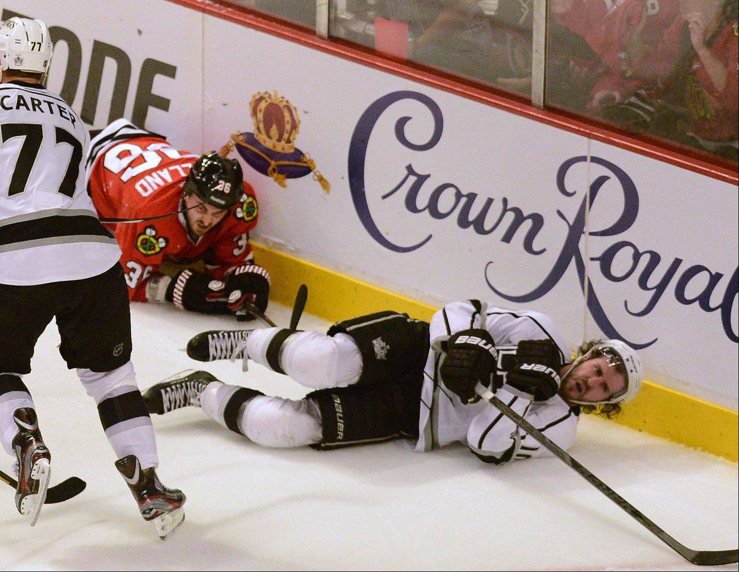 The Kings' Mike Richards protests after being leveled by Dave Bolland in third-period action in Game 1 of the Western Conference finals between the Chicago Blackhawks and the Los Angeles Kings.