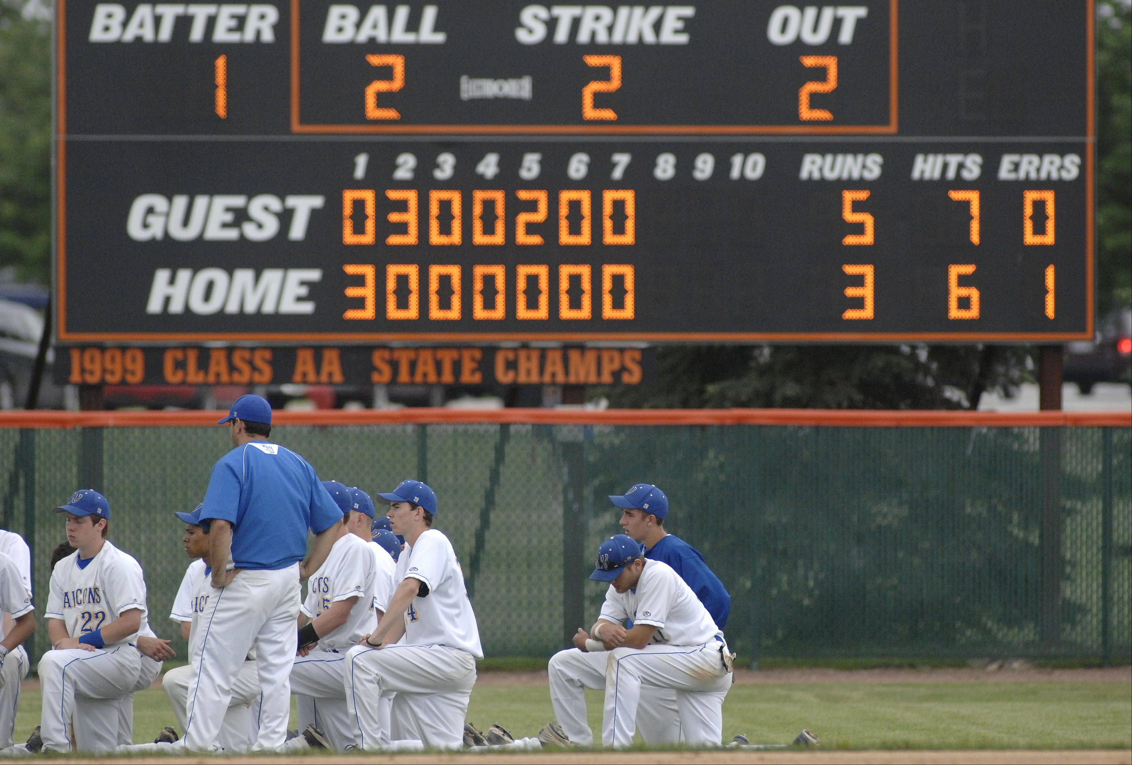 Wheaton North players listen to their coaches talk after their Class 4A sectional championship loss to St. Charles East on Saturday, June 1.
