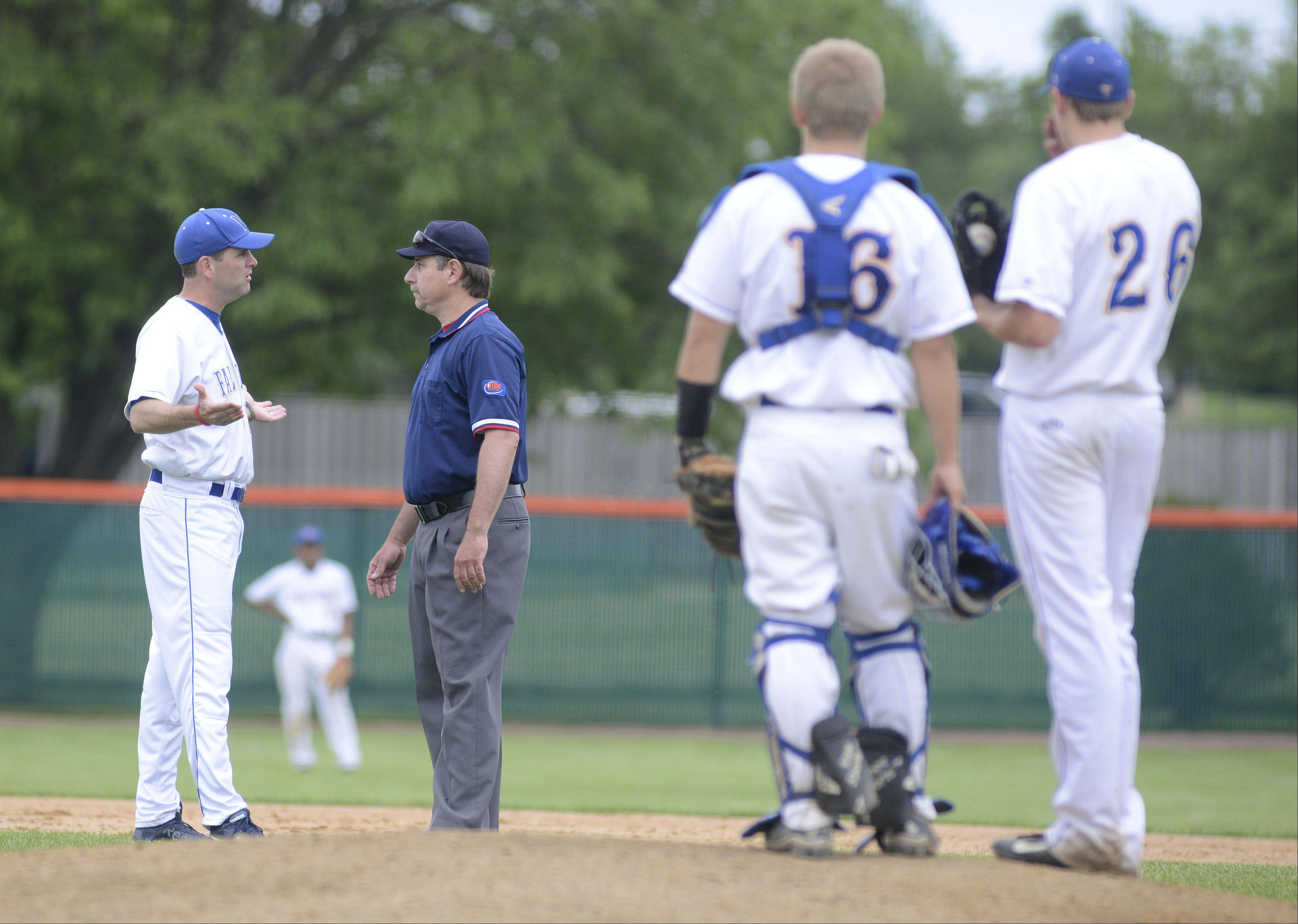 Wheaton North coach Dan Schoessling disputes a call by an umpire after St. Charles East scored a run in the fifth inning of the Class 4A sectional championship in St. Charles on Saturday, June 1.