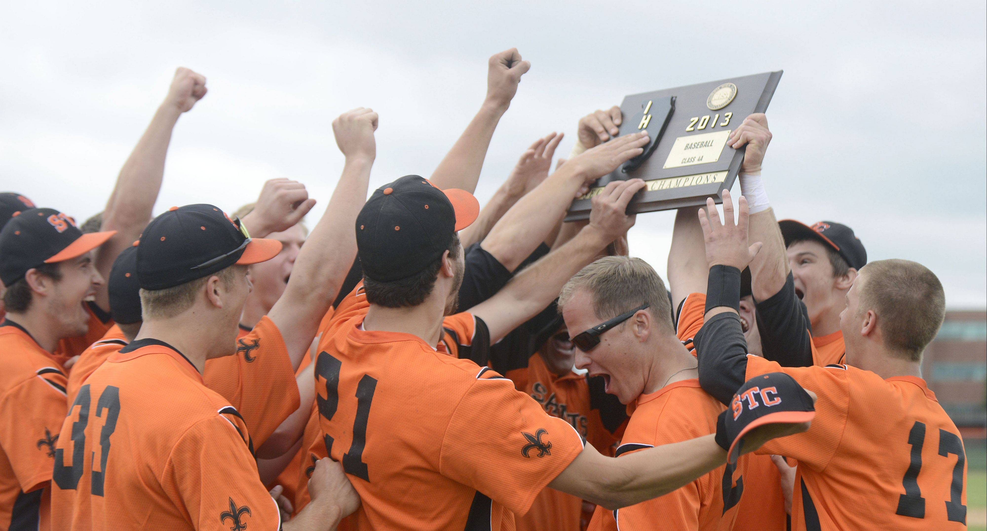 St. Charles East celebrates its Class 4A sectional championship over Wheaton North on Saturday in St. Charles.