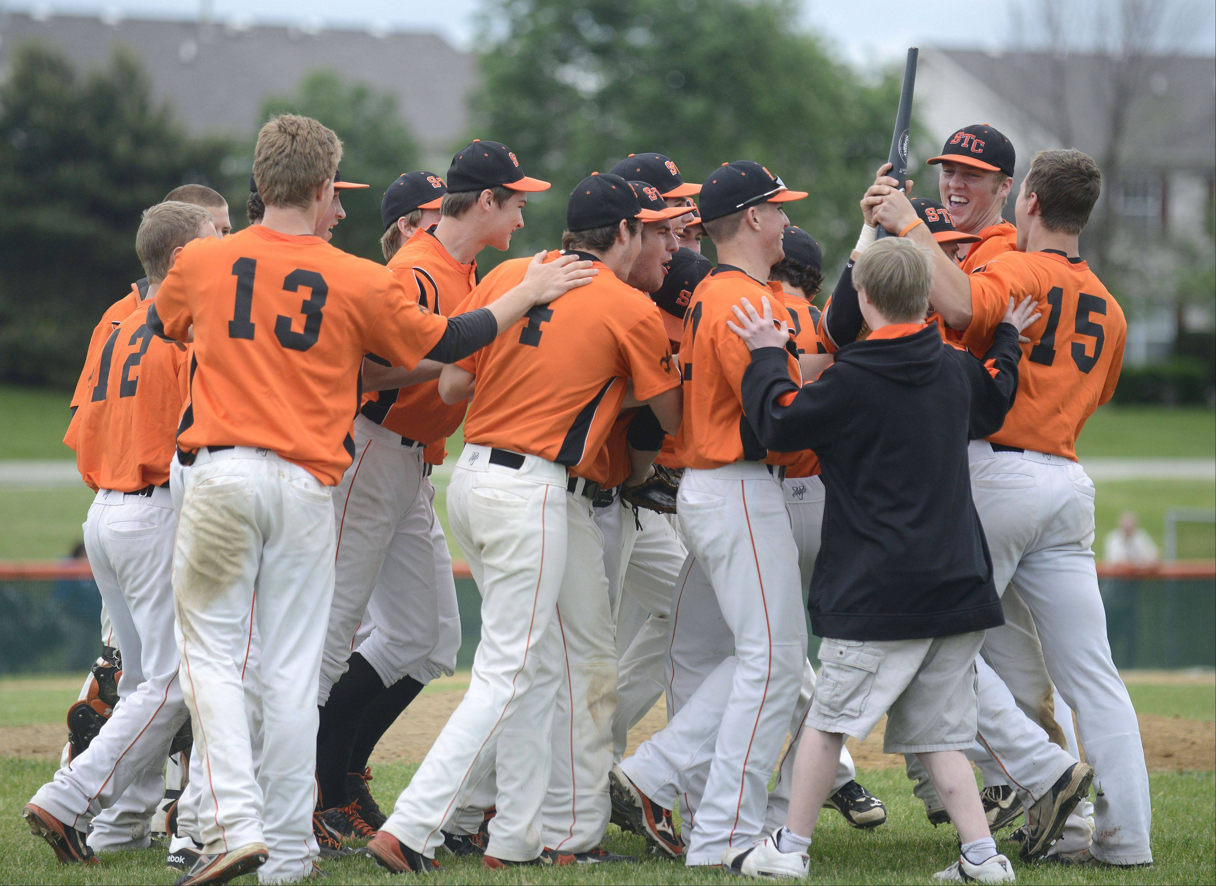 St. Charles East celebrates their Class 4A sectional championship over Wheaton North on Saturday, June 1.