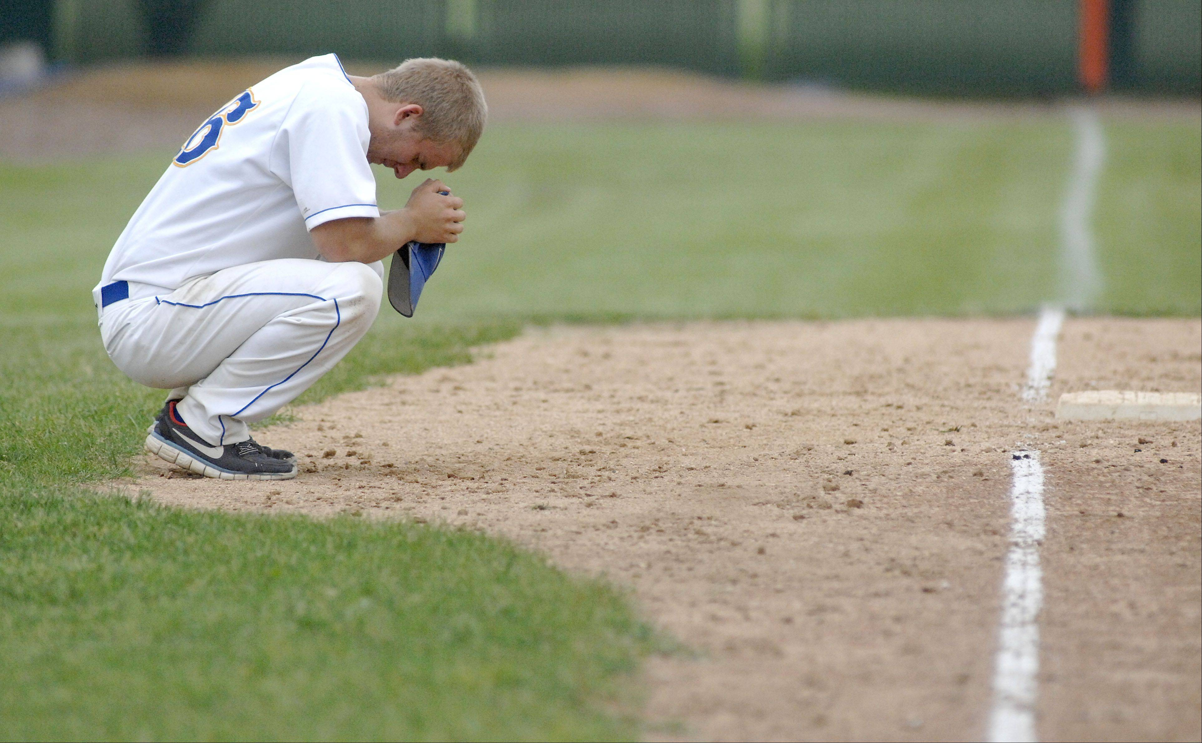 Wheaton North senior Tom Cassier takes a moment for himself to collect his thoughts near third base after their Class 4A sectional championship loss to St. Charles East on Saturday, June 1.