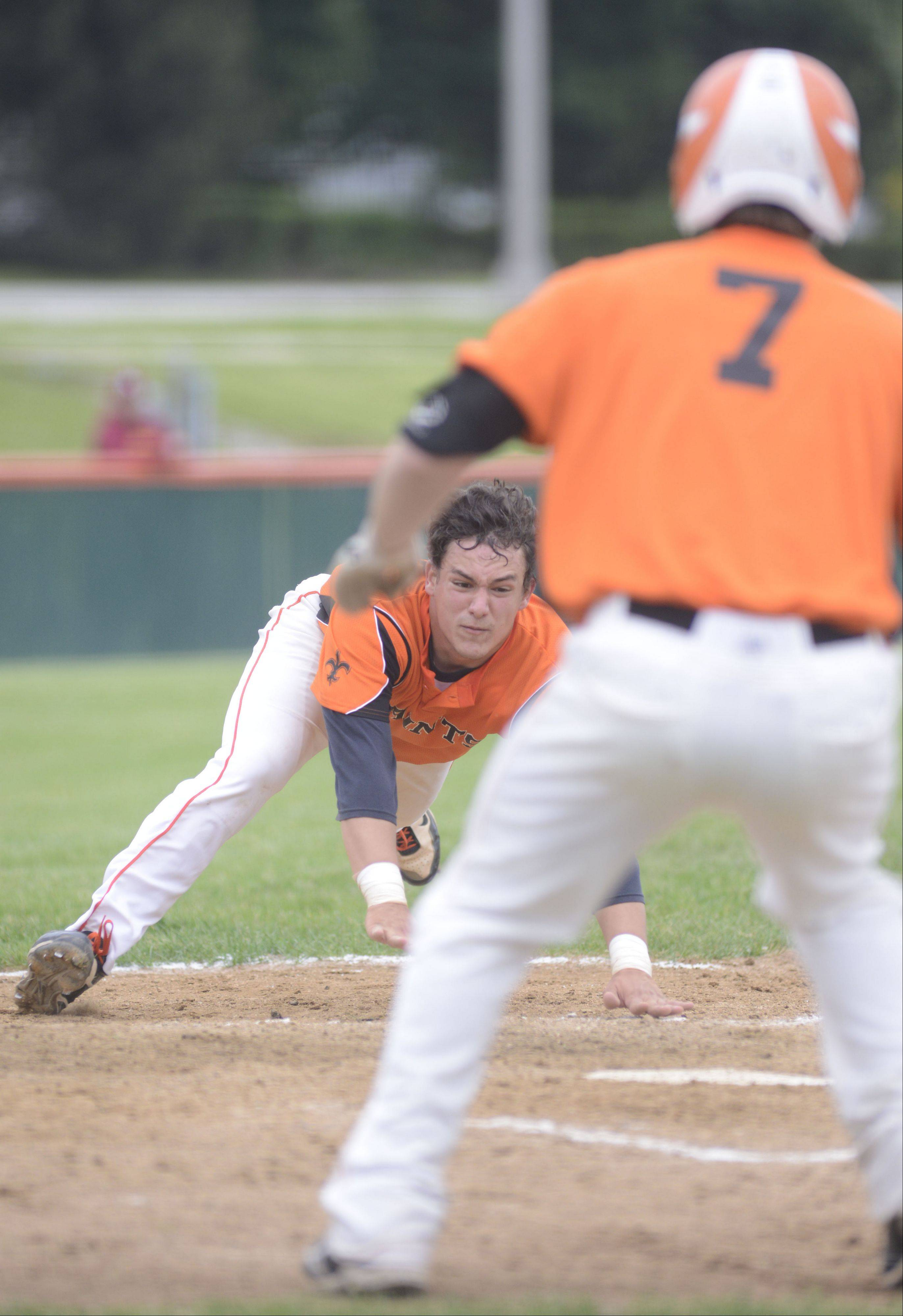 St. Charles East's Anthony Sciarrino dives headfirst toward home plate in front of teammate Nick Huskisson to score and break the tie in the fifth inning of the Class 4A sectional championship vs. Wheaton North on Saturday, June 1.