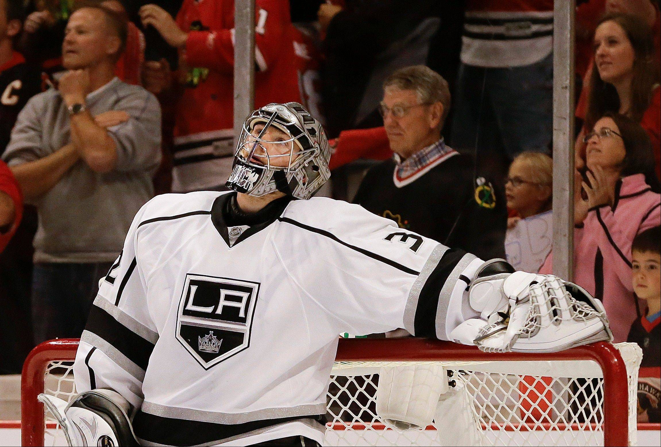 Los Angeles Kings goalie Jonathan Quick looks up at the scoreboard after a goal by the Chicago Blackhawks in the second period of Game 1 of the NHL hockey Stanley Cup Western Conference finals, Saturday, June 1, 2013, in Chicago.