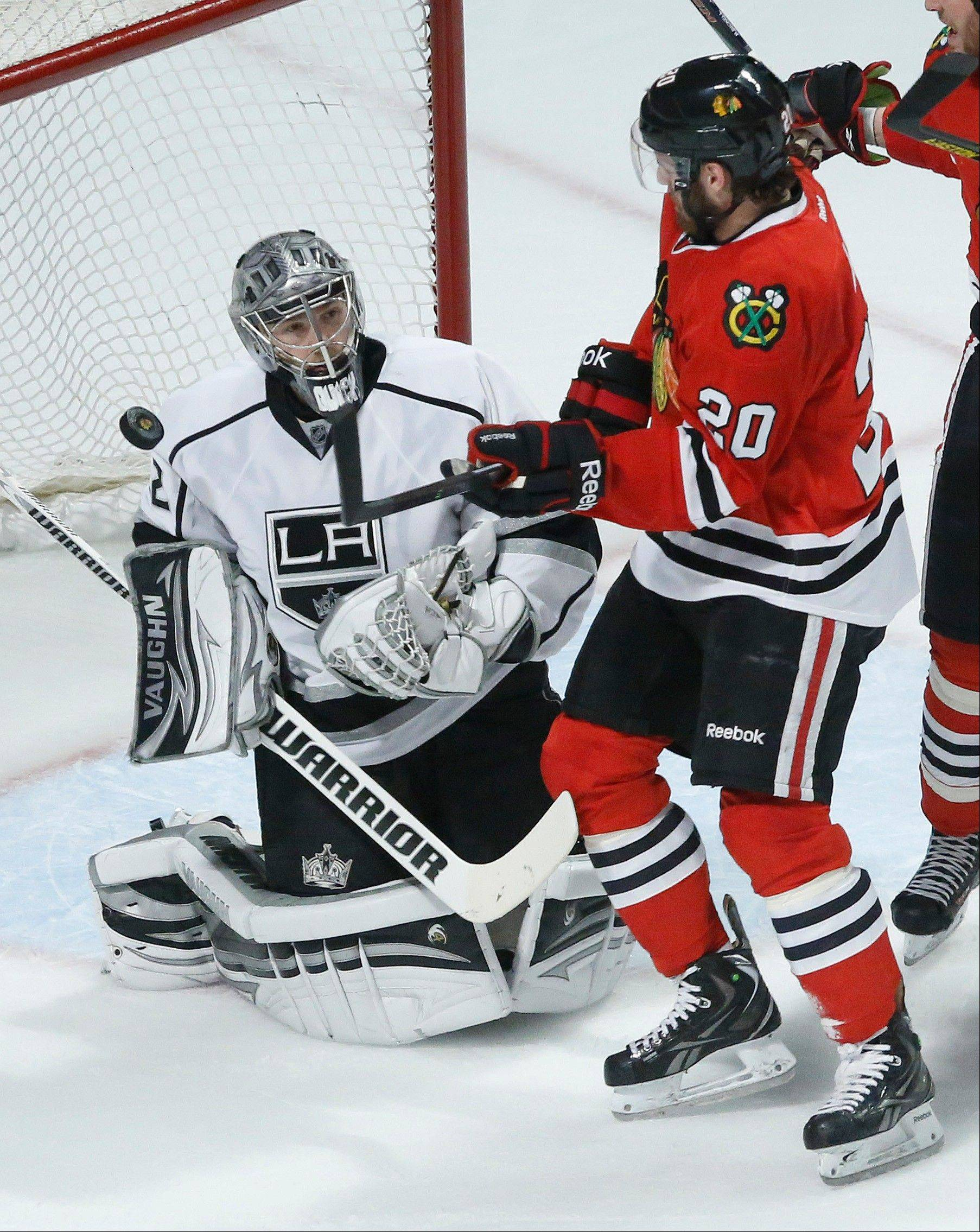 Los Angeles Kings goalie Jonathan Quick (32) blocks a shot by Chicago Blackhawks left wing Brandon Saad (20) during the first period in Game 1 of the NHL hockey Stanley Cup Western Conference finals Saturday, June 1, 2013, in Chicago.
