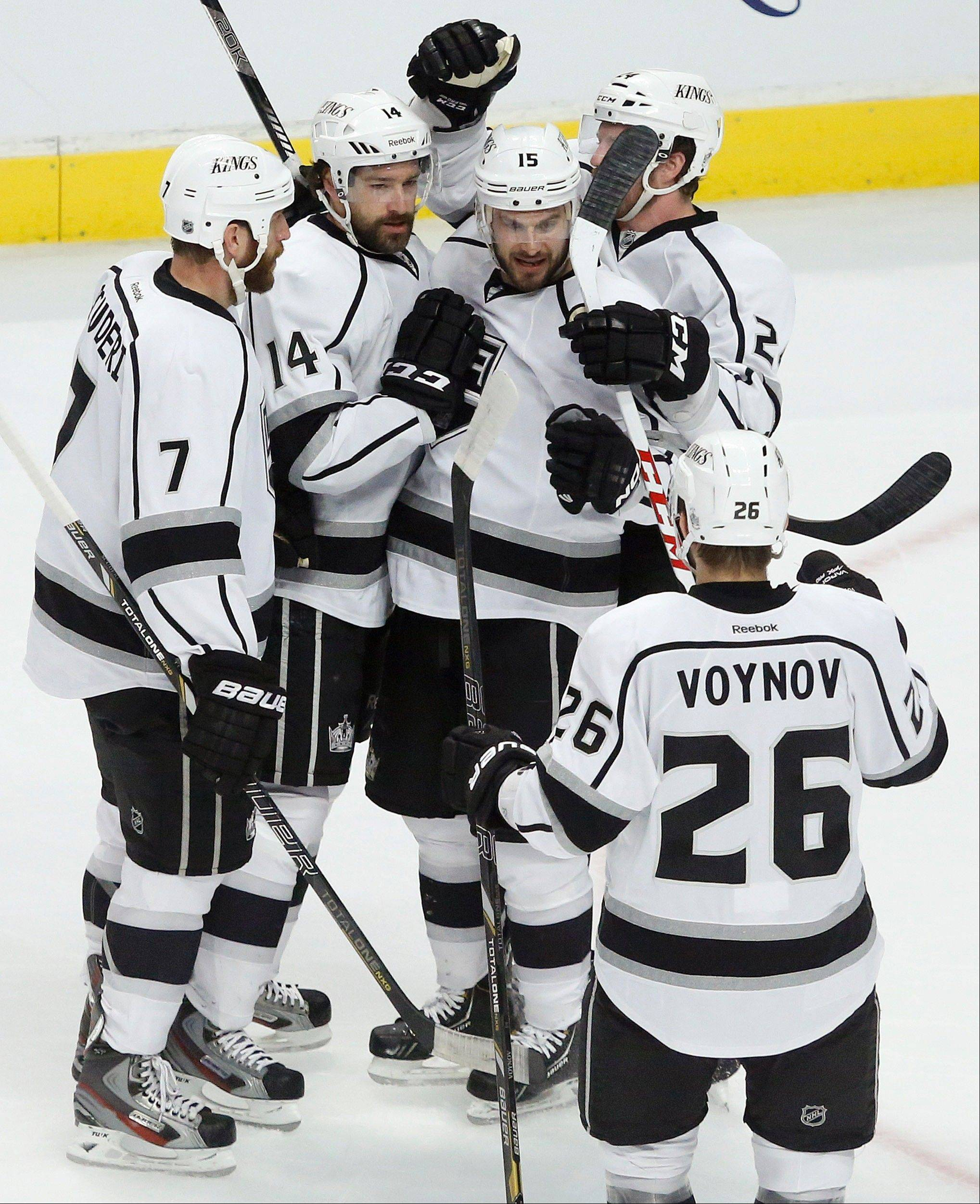 From left, Los Angeles Kings' Rob Scuderi (7), Justin Williams, Brad Richardson, Colin Fraser and Slava Voynov celebrate after Williams scored a goal against the Chicago Blackhawks during the first period in Game 1 of the NHL hockey Stanley Cup Western Conference finals Saturday, June 1, 2013, in Chicago.
