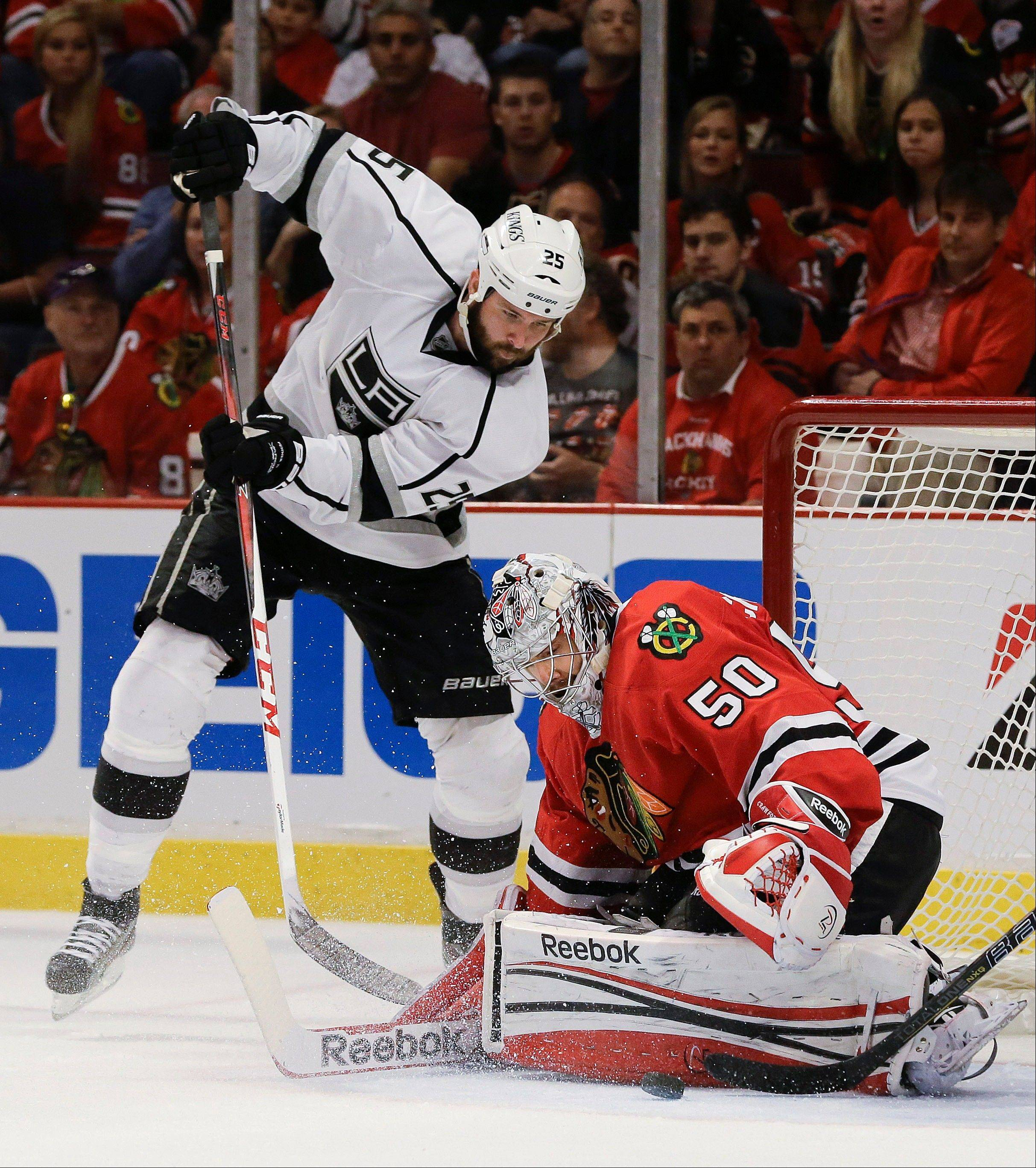 Chicago Blackhawks goalie Corey Crawford (50) blocks a shot attempt by Los Angeles Kings left wing Dustin Penner (25) during the third period of Game 1 of the NHL hockey Stanley Cup Western Conference finals, Saturday, June 1, 2013, in Chicago. Chicago won 2-1.