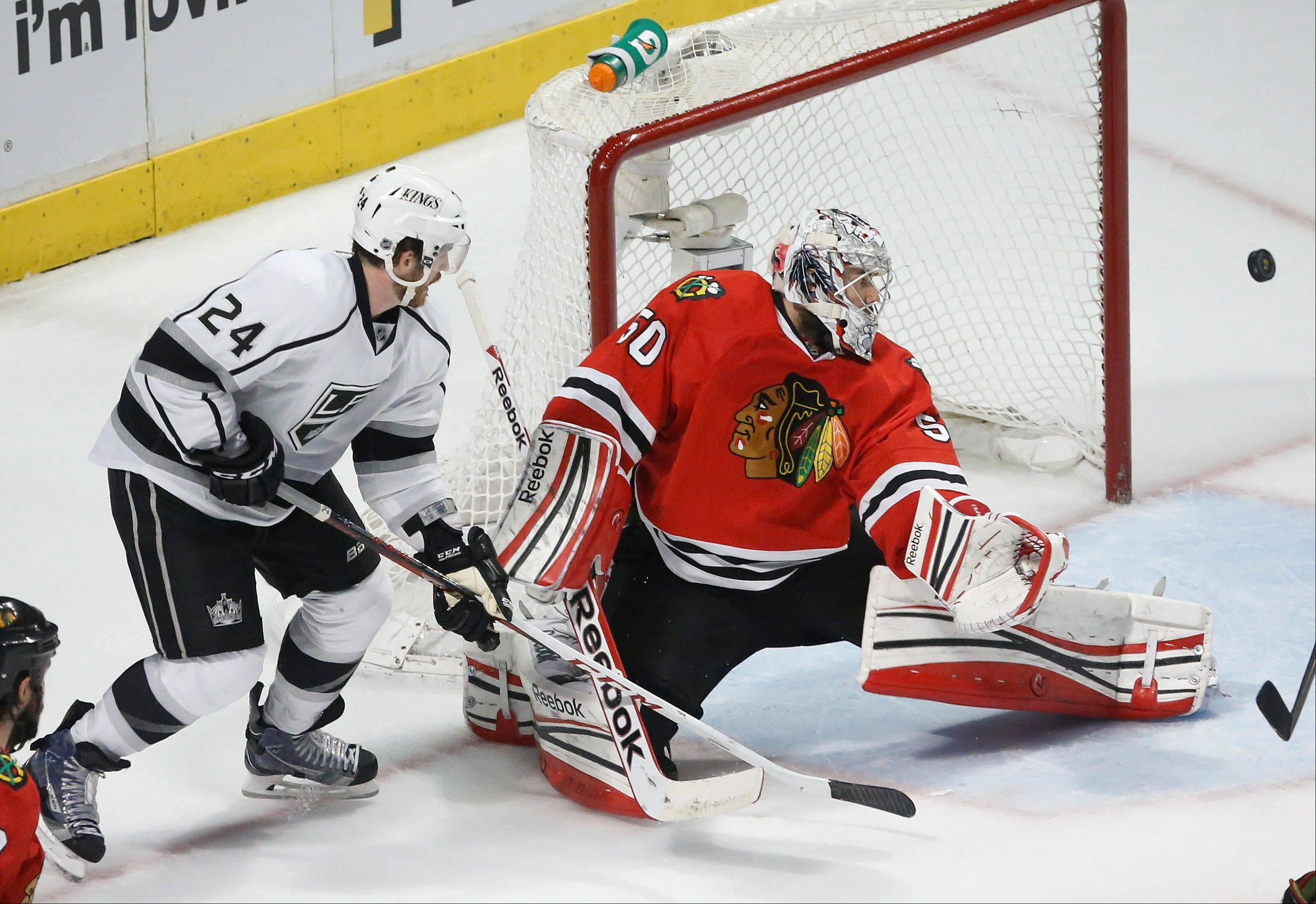 Chicago Blackhawks goalie Corey Crawford (50) defects a shot by Los Angeles Kings center Colin Fraser (24) during the second period in Game 1 of the NHL hockey Stanley Cup Western Conference finals Saturday, June 1, 2013, in Chicago.