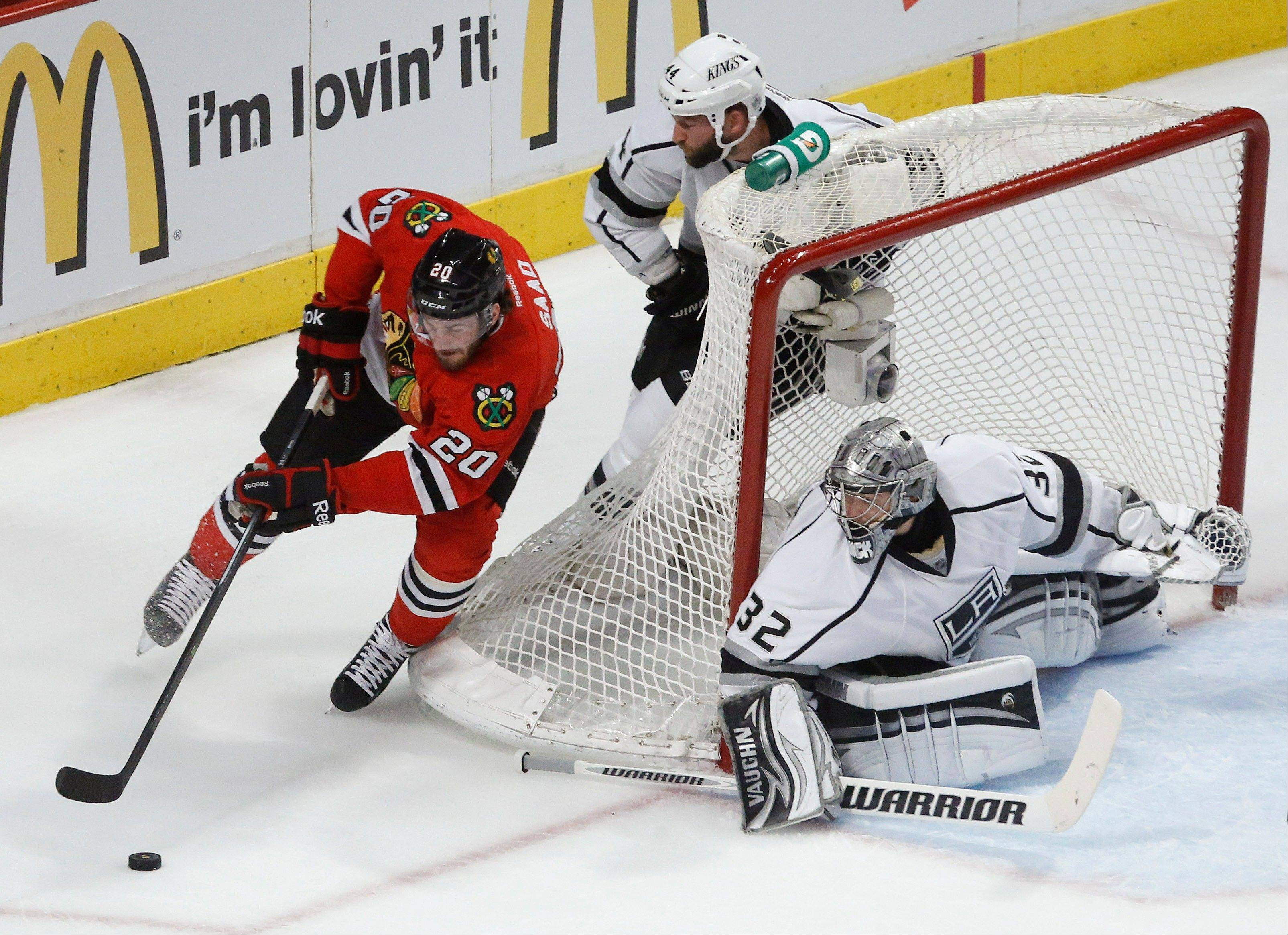 Chicago Blackhawks left wing Brandon Saad (20) looks to score against Los Angeles Kings goalie Jonathan Quick (32) in the first period in Game 1 of the NHL hockey Stanley Cup Western Conference finals Saturday, June 1, 2013, in Chicago.