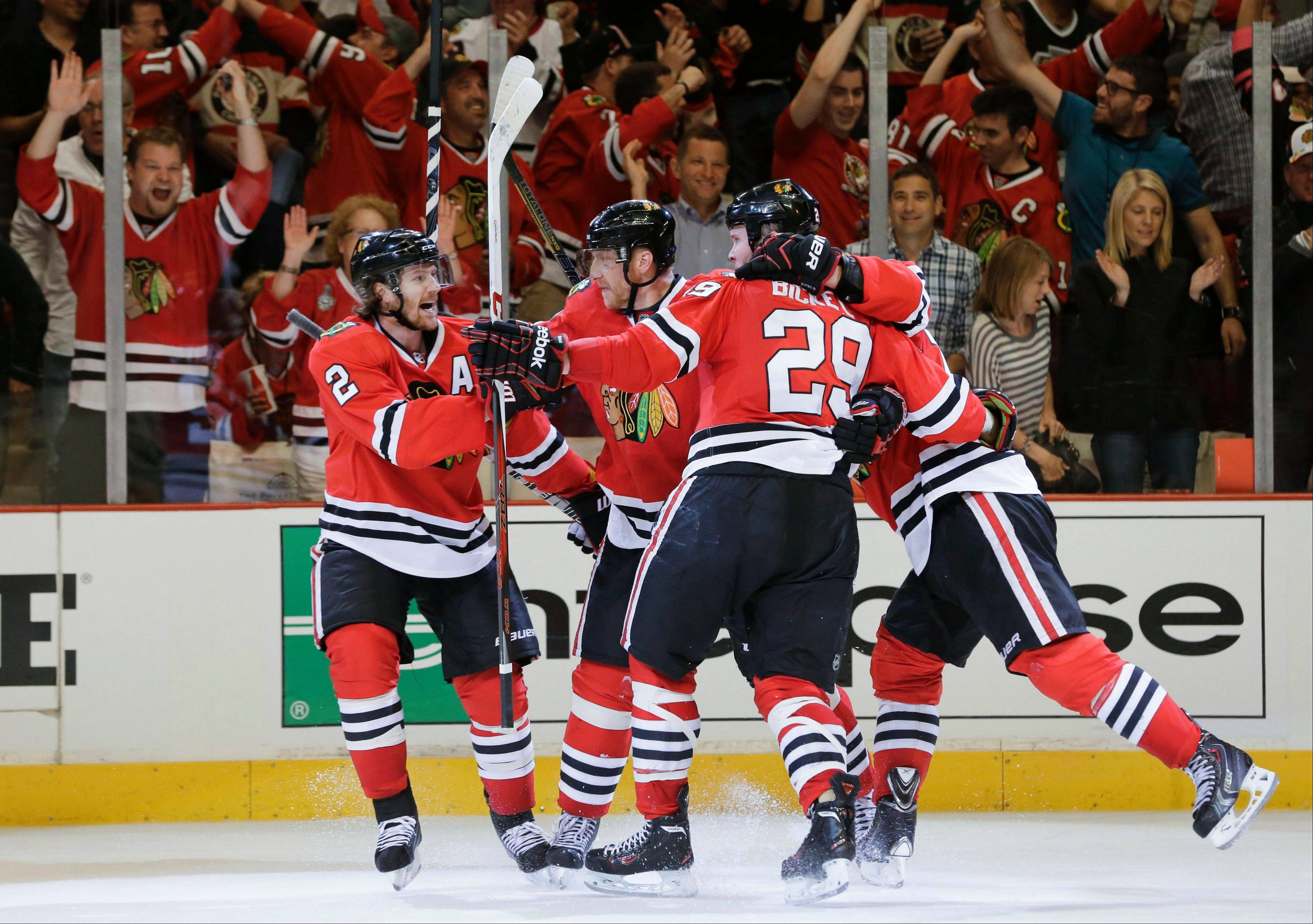 The Chicago Blackhawks celebrate after a goal against the Los Angeles Kings during the second period of Game 1 of the NHL hockey Stanley Cup Western Conference finals, Saturday, June 1, 2013, in Chicago.