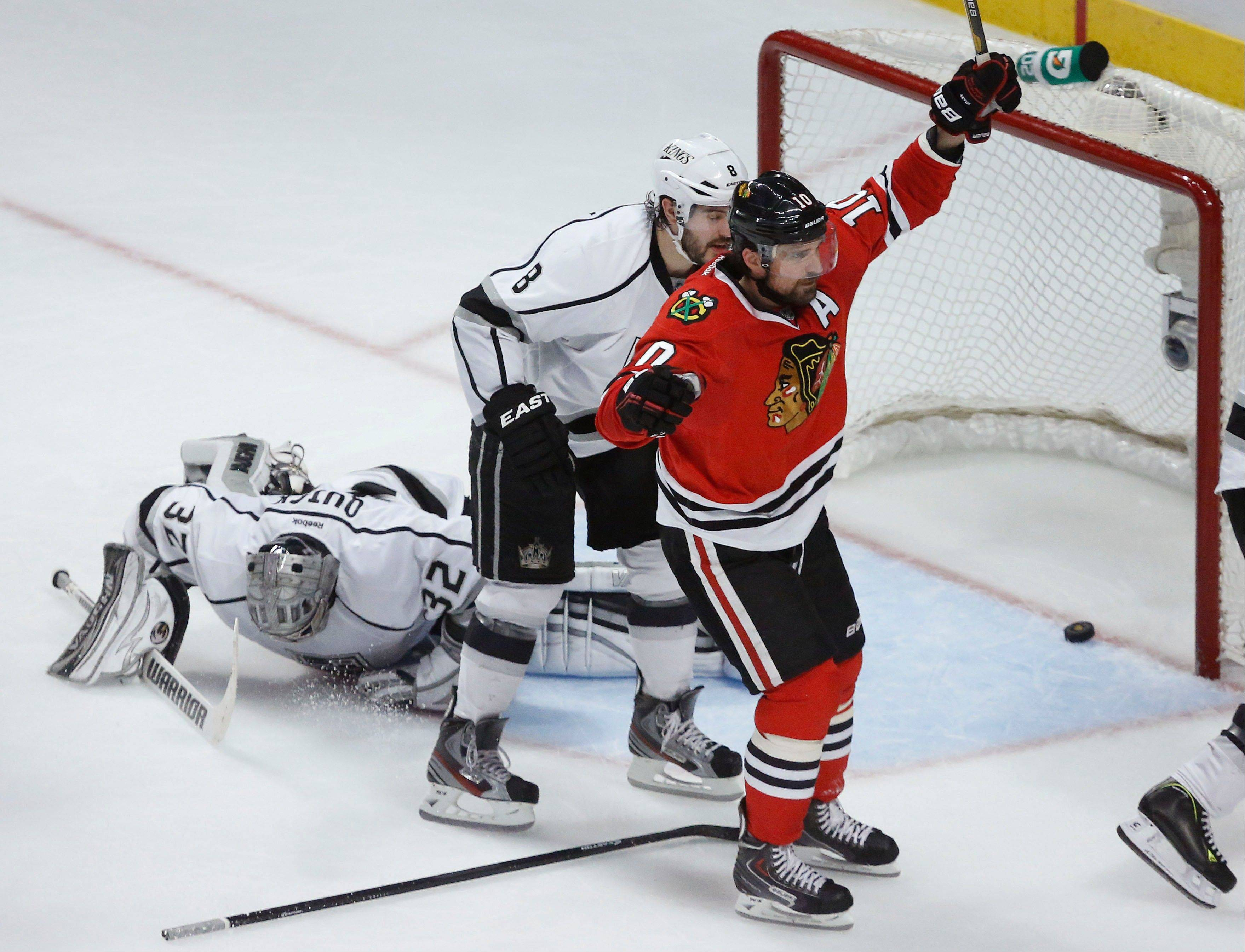Chicago Blackhawks center Patrick Sharp (10) reacts after scoring a goal against Los Angeles Kings goalie Jonathan Quick (32) during the second period in Game 1 of the NHL hockey Stanley Cup Western Conference finals Saturday, June 1, 2013, in Chicago.