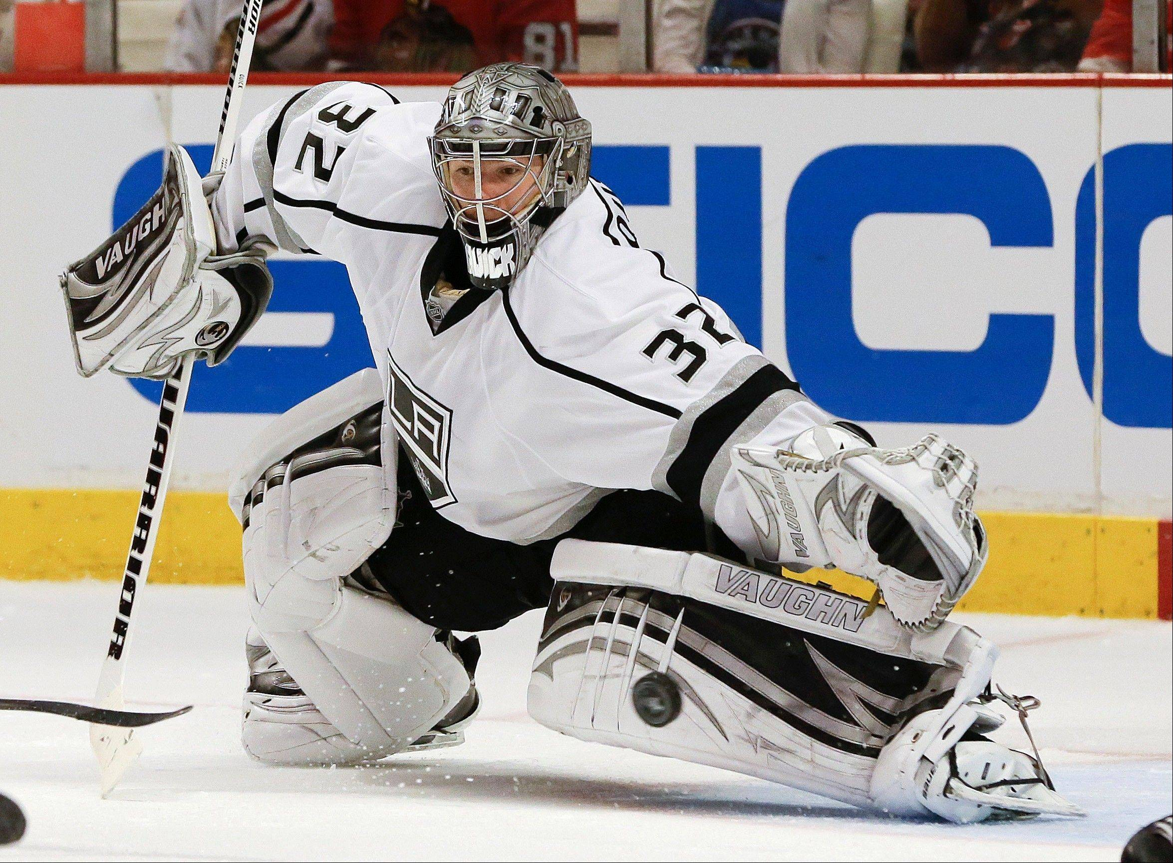 The puck gets by Los Angeles Kings goalie Jonathan Quick for a goal by Chicago Blackhawks center Patrick Sharp during the second period of Game 1 of the NHL hockey Stanley Cup Western Conference finals, Saturday, June 1, 2013,in Chicago.