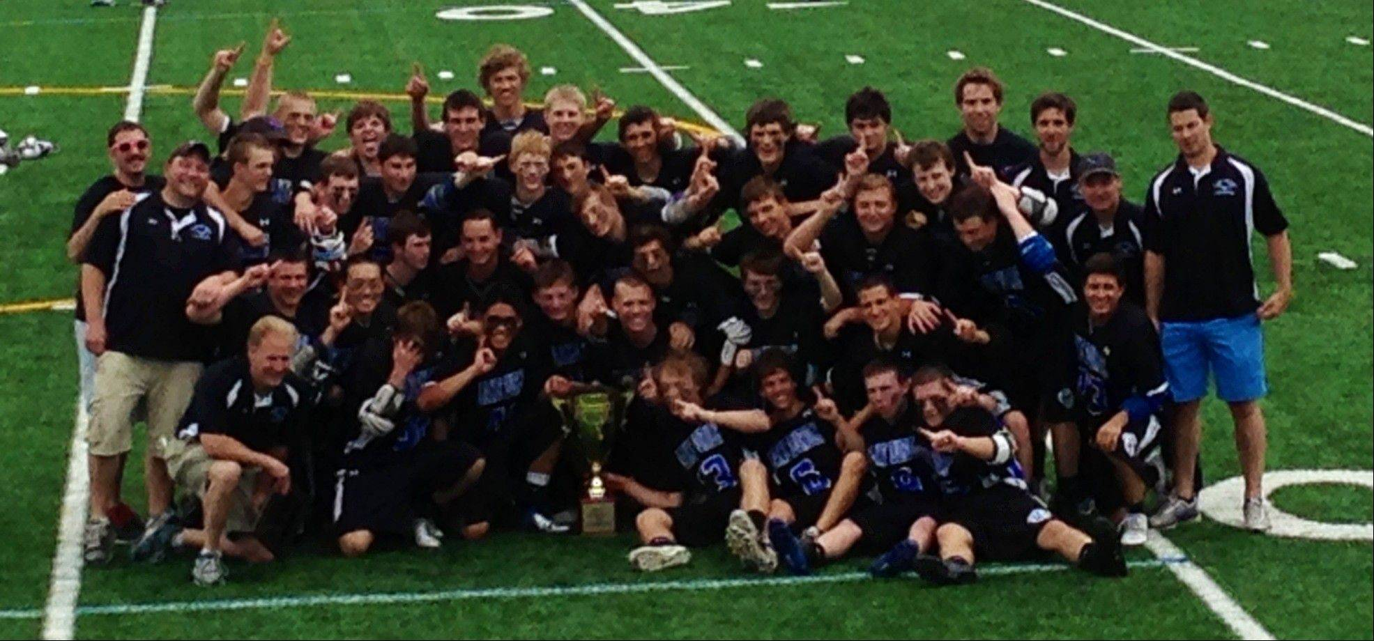 Lake Zurich's boys lacrosse team celebrates after beating Naperville Central 13-6 to capture the Lacrosse Cup at New Trier on Saturday.