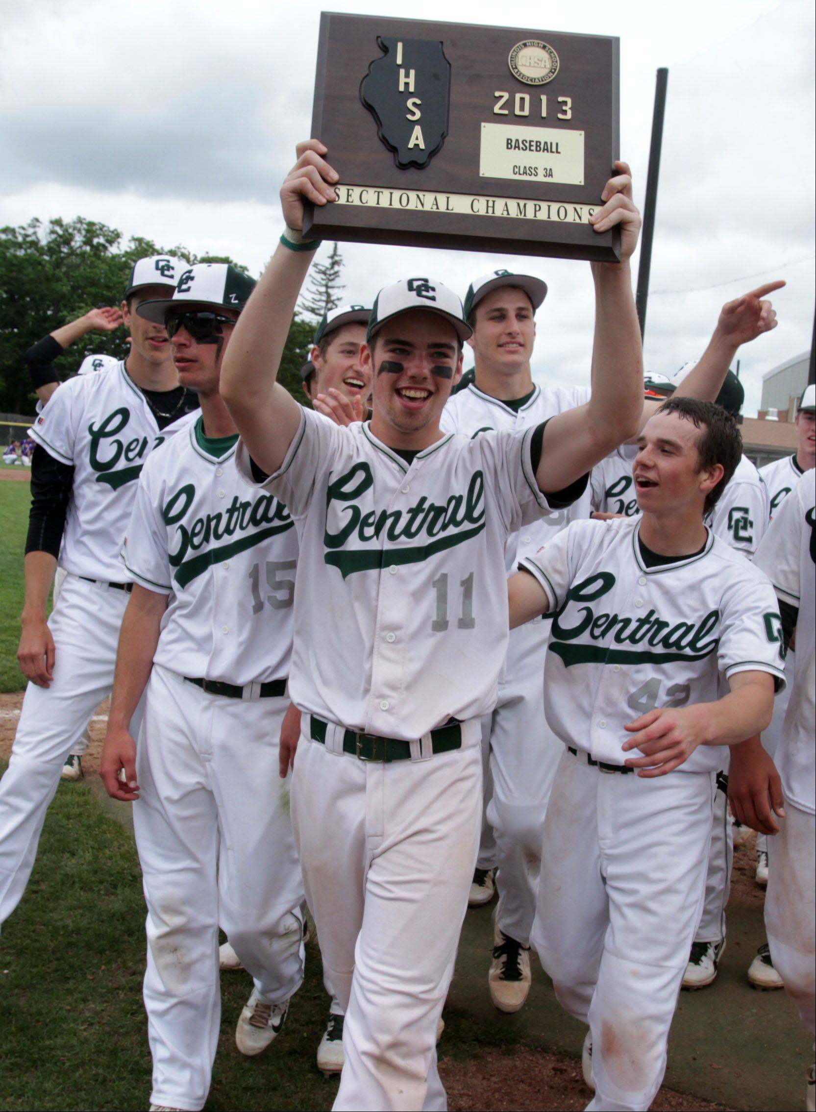 Grayslake Central's Justin Allen and teammates celebrate with the Class 3A Grayslake Central sectional plaque after topping Wauconda 6-4 on Saturday.