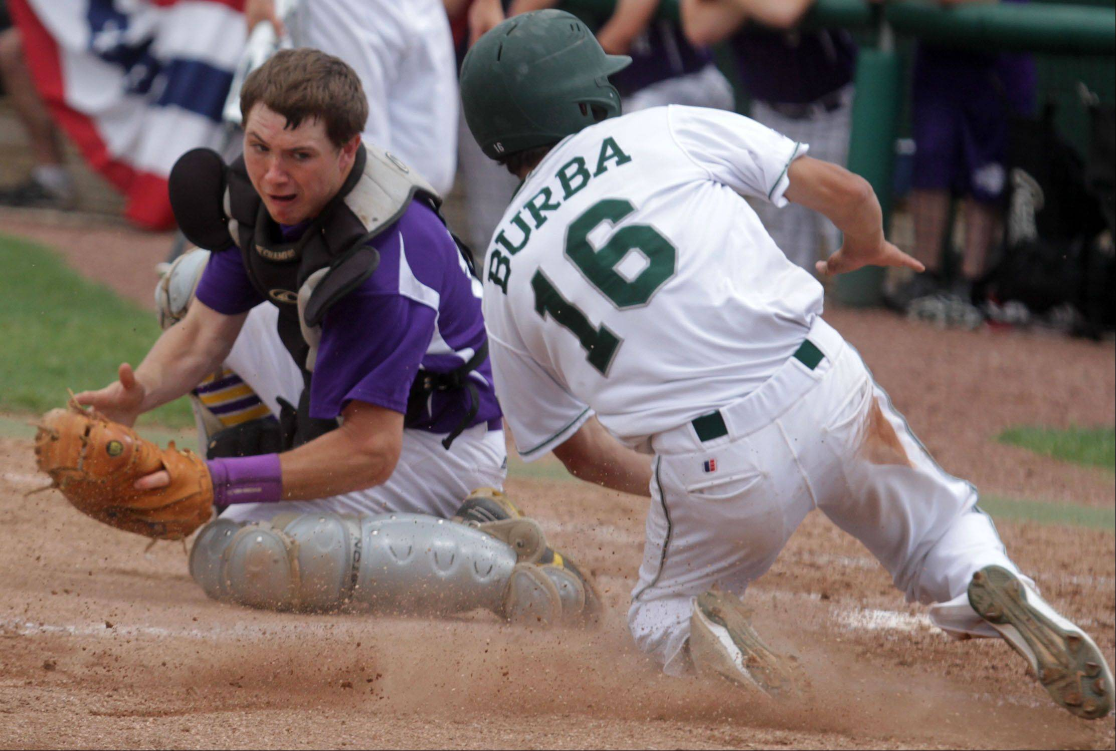 Wauconda catcher Kyle Bock, with the ball in his glove, can't quite tag Grayslake Central's Pat Burba, who scores in the Rams' 6-4 sectional championship effort Saturday.