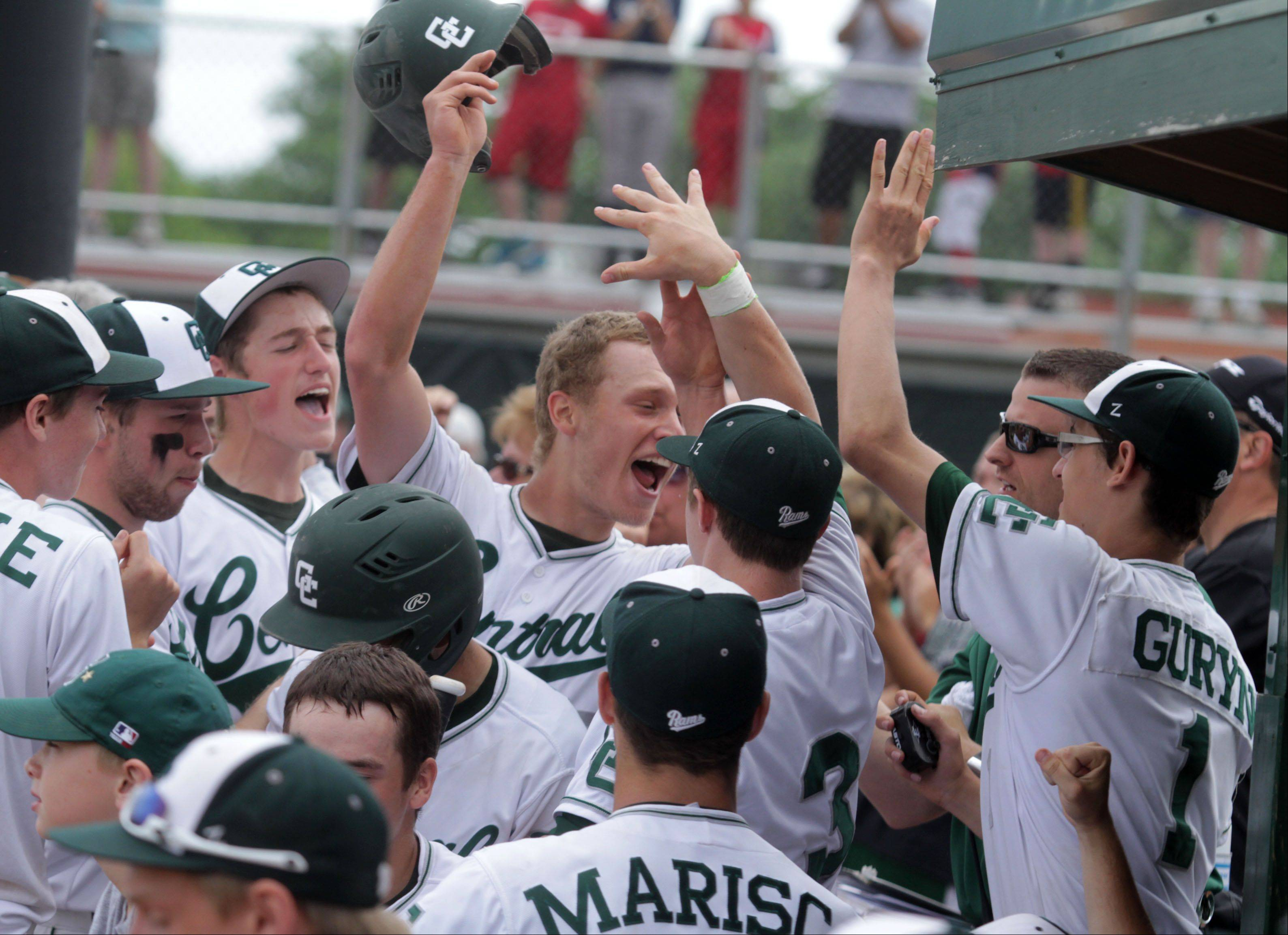 Grayslake Central's Kyle Balling celebrates scoring while he enters the dugout during the Rams' sectional championship effort Saturday.