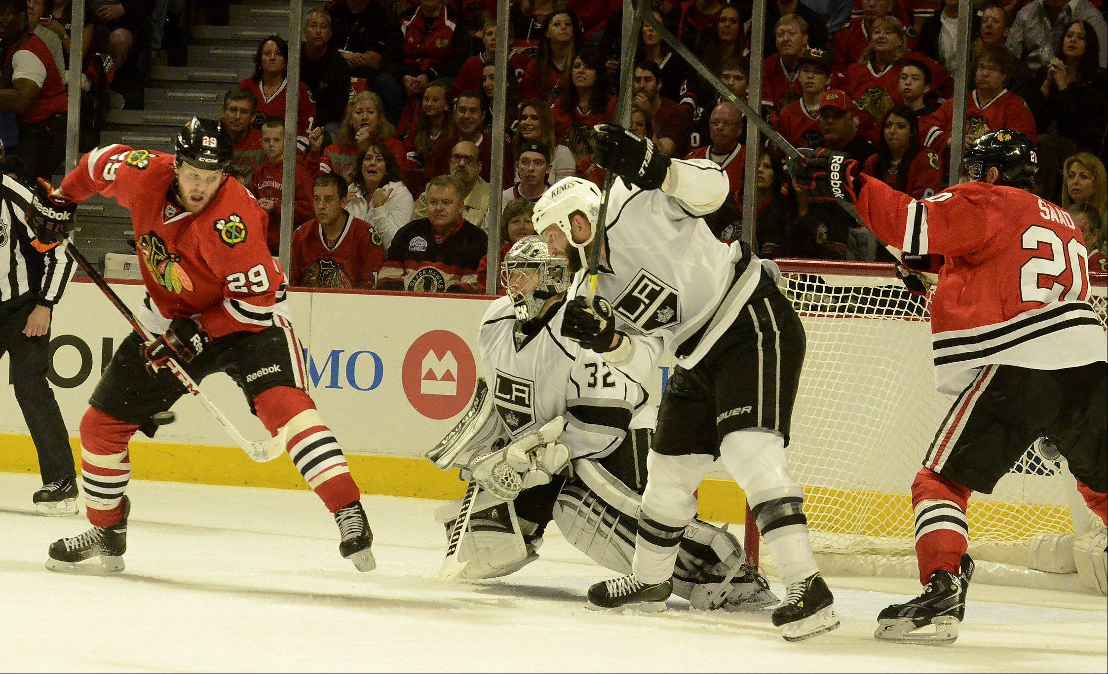 Bryan Bickell and Brandon Saad pressure King's goalie Jonathan Quick in first period action in game 1 of the Western Conference finals between the Chicago Blackhawks and the Los Angeles Kings.