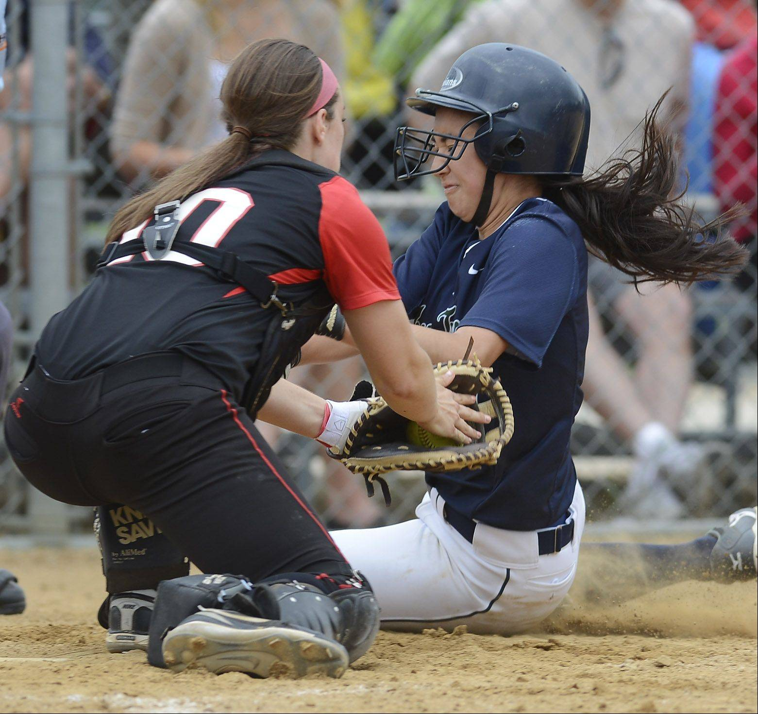 Barrington catcher Reagan Fingerman tags out New Trier's Alexa Caruso at the plate during the Rolling Meadows sectional final Saturday.