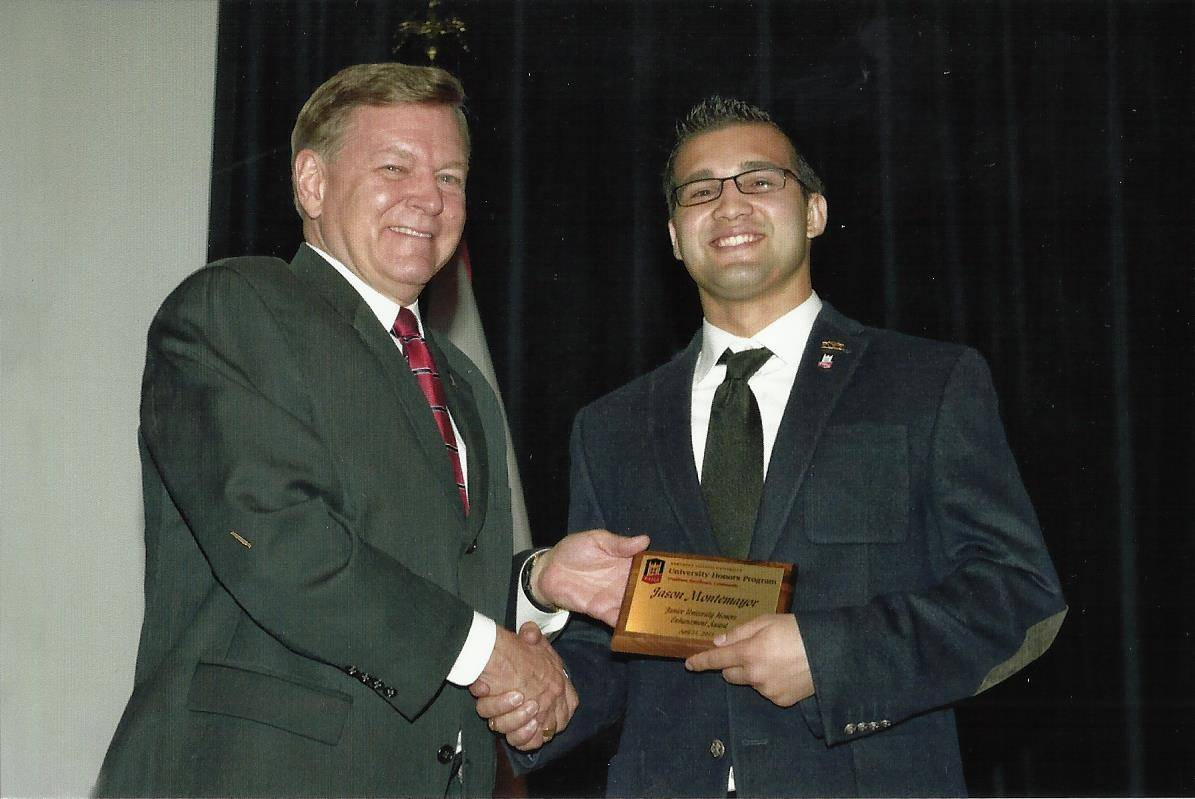 PROVOST RAY ALDEN PRESENTED THE AWARD TO JASON MONTEMAYOR