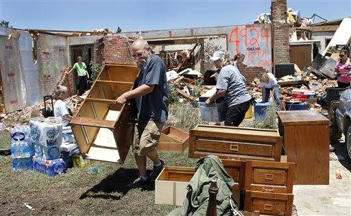 People arrived at Fred and JoAnn Horn's home to help in their salvage efforts, Saturda in El Reno, Okla. .