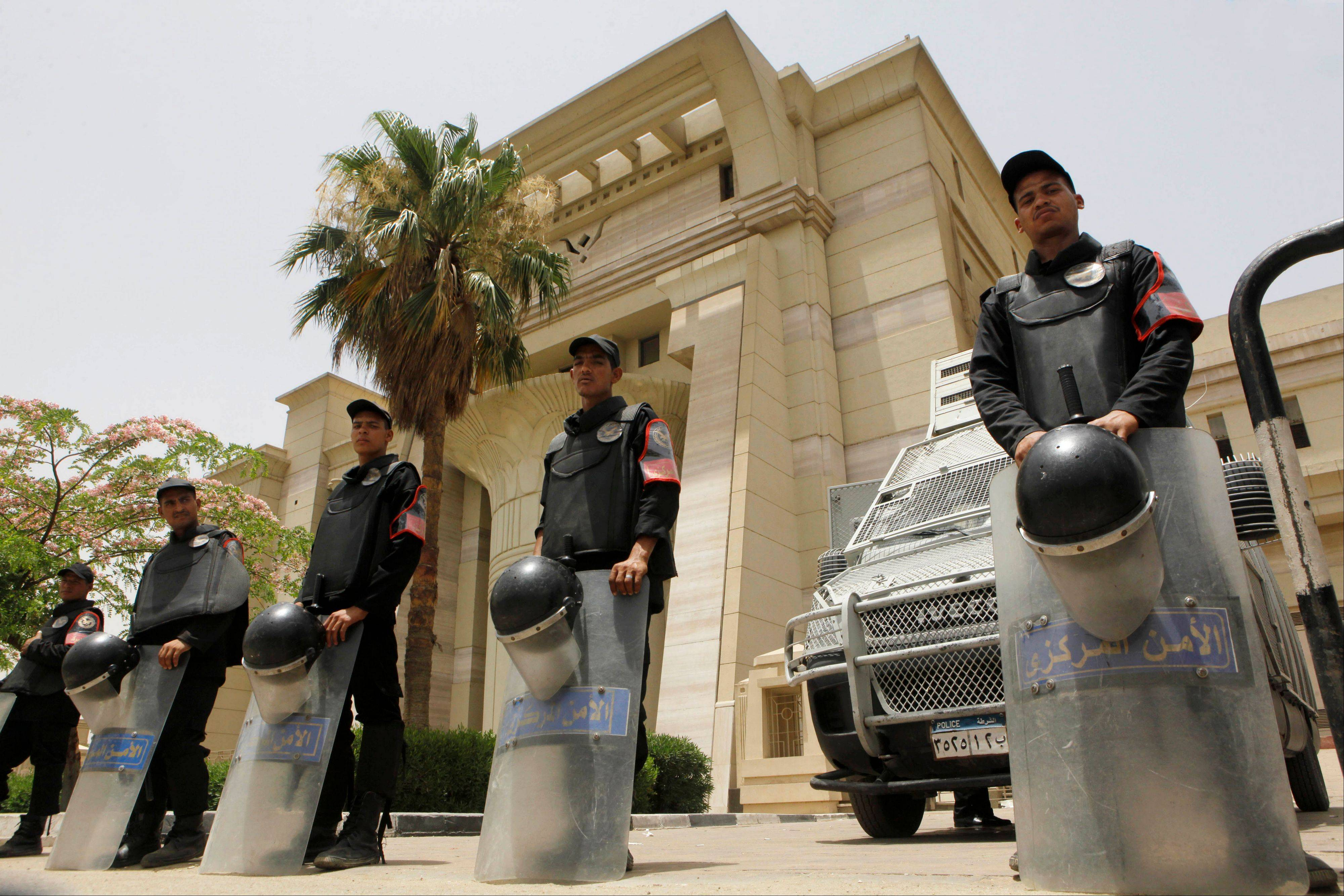 Egyptian anti-riot police stand gurad in front of the Supreme Constitutional Court in Cairo, Egypt, Sunday. An Egyptian court ruled Sunday the nation�s Islamist-dominated legislature and constitutional panel were illegally elected and that the legislature�s upper house, the only one currently sitting, must be dissolved when parliament�s lower chamber is elected later this year or early in 2014.