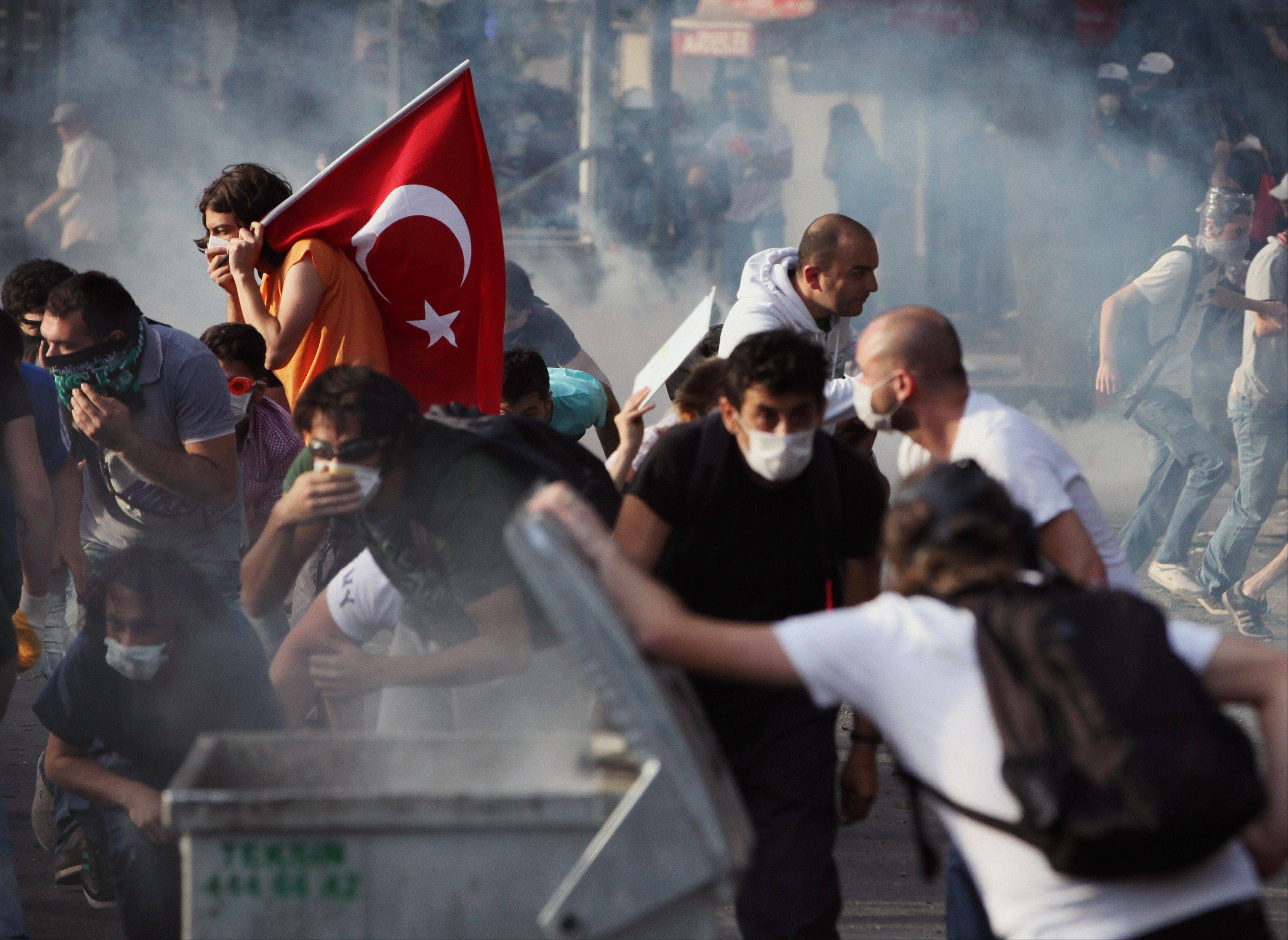Young Turks clash with security forces in Ankara, Turkey, Sunday. The demonstrations grew out of anger over a violent police crackdown of a peaceful environmental protest at Istanbul's Taksim Square and spread to other Turkish cities.