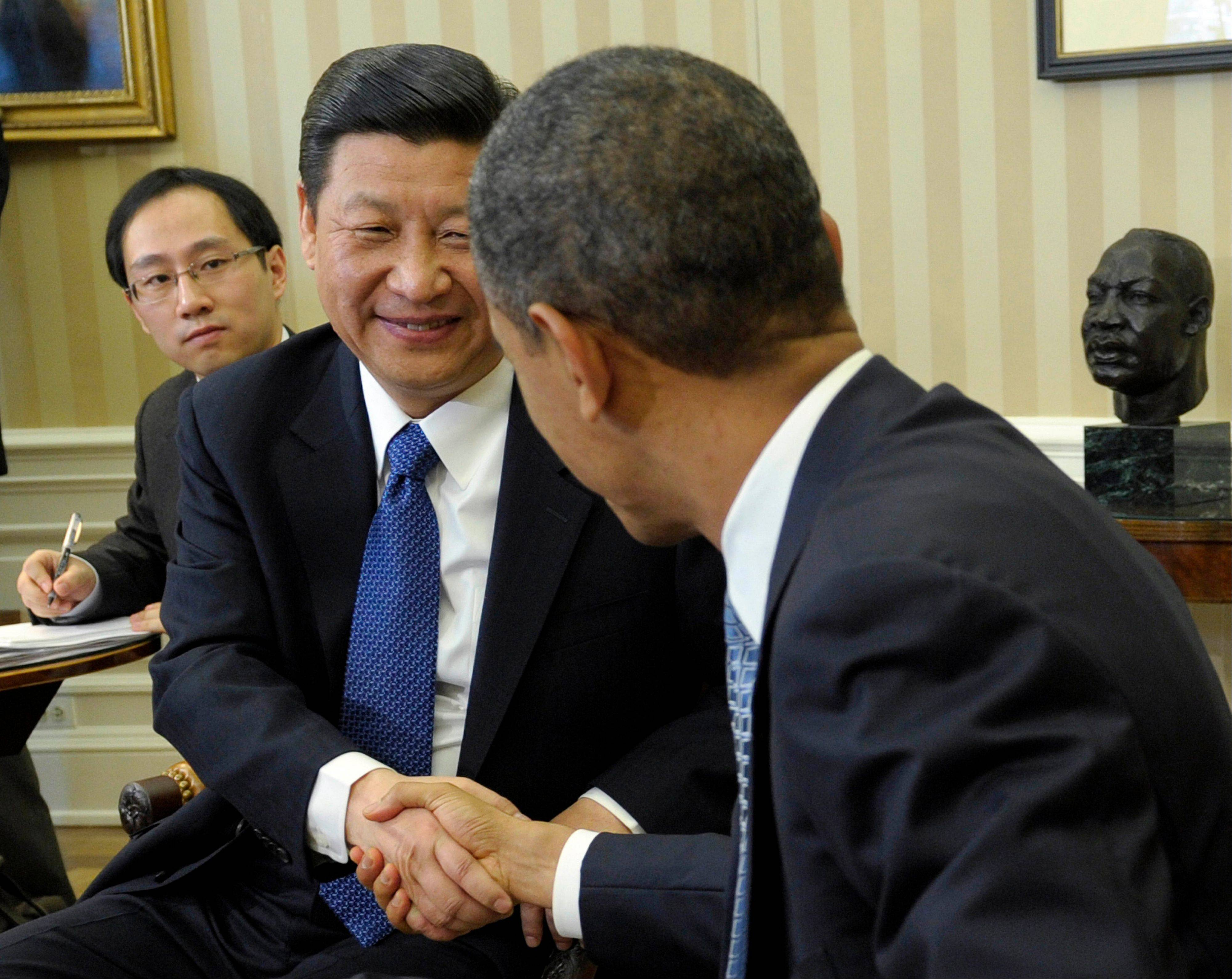 President Barack Obama and Chinese Vice President Xi Jinping, left, visit at the White House Feb. 14, 2012. When Obama meets Jinping again this week, he will be visiting with China's president — and cybersecurity will be high among issues that will be raised.