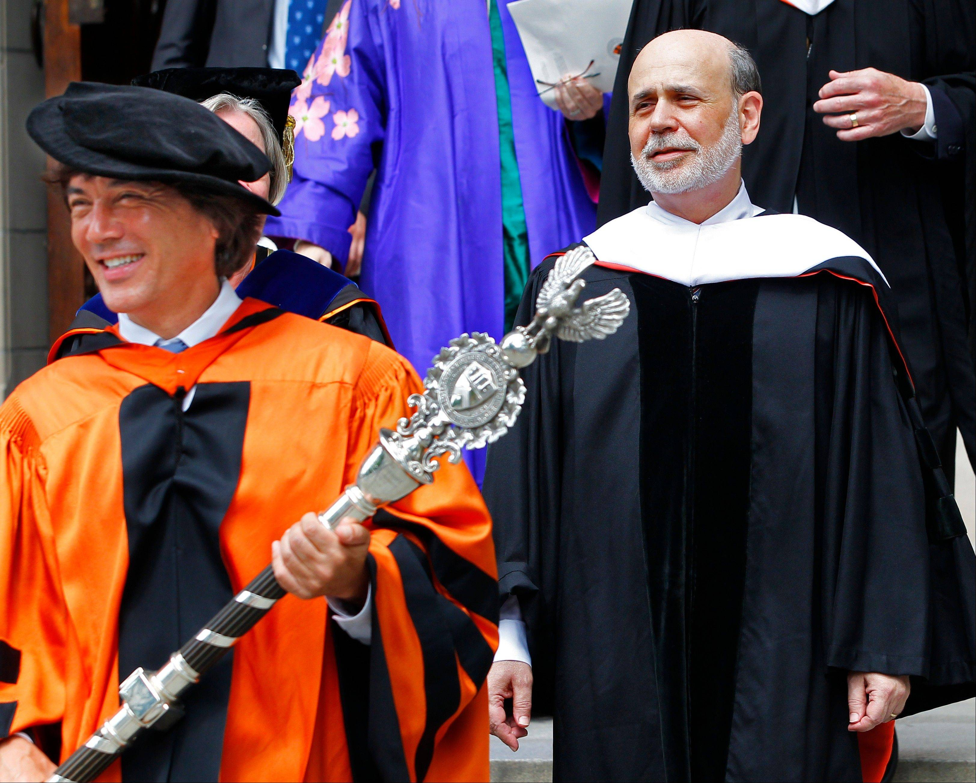 Princeton University's Dr. Jeff Nunokawa, Professor of English, holds the the school's ceremonial mace as Ben S. Bernanke, Chairman of the Federal Reserve, leads the processional out of Princeton University Chapel after giving the Baccalaureate address Sunday.