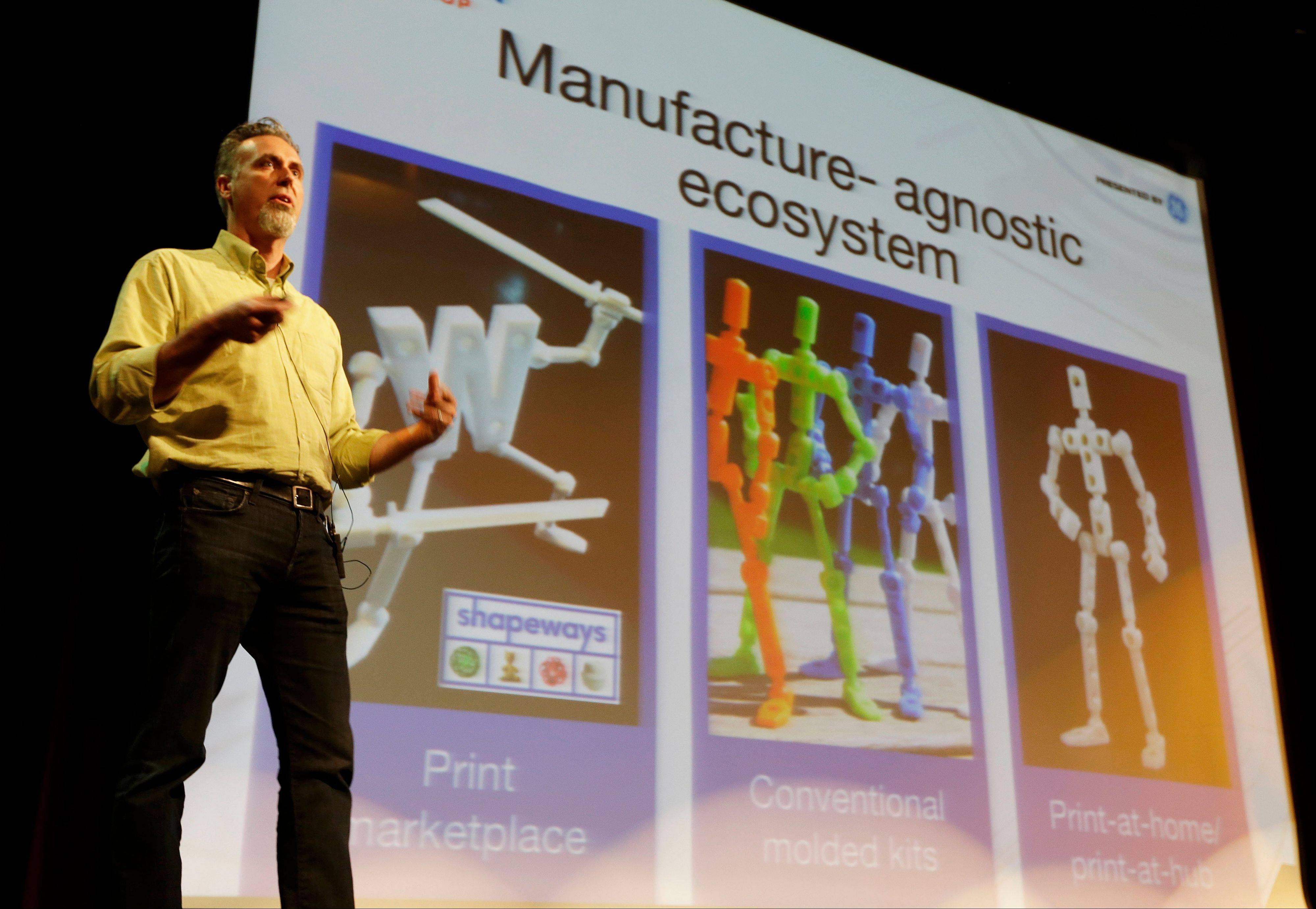 Wayne Losey, co-founder of Dynamo DevLabs, speaks about 3-D printing during the Hardware Innovation Workshop in San Mateo, Calif., May 13. With the printers users make whatever they like, iPad stands, guitars, jewelry, someone even made a rifle.