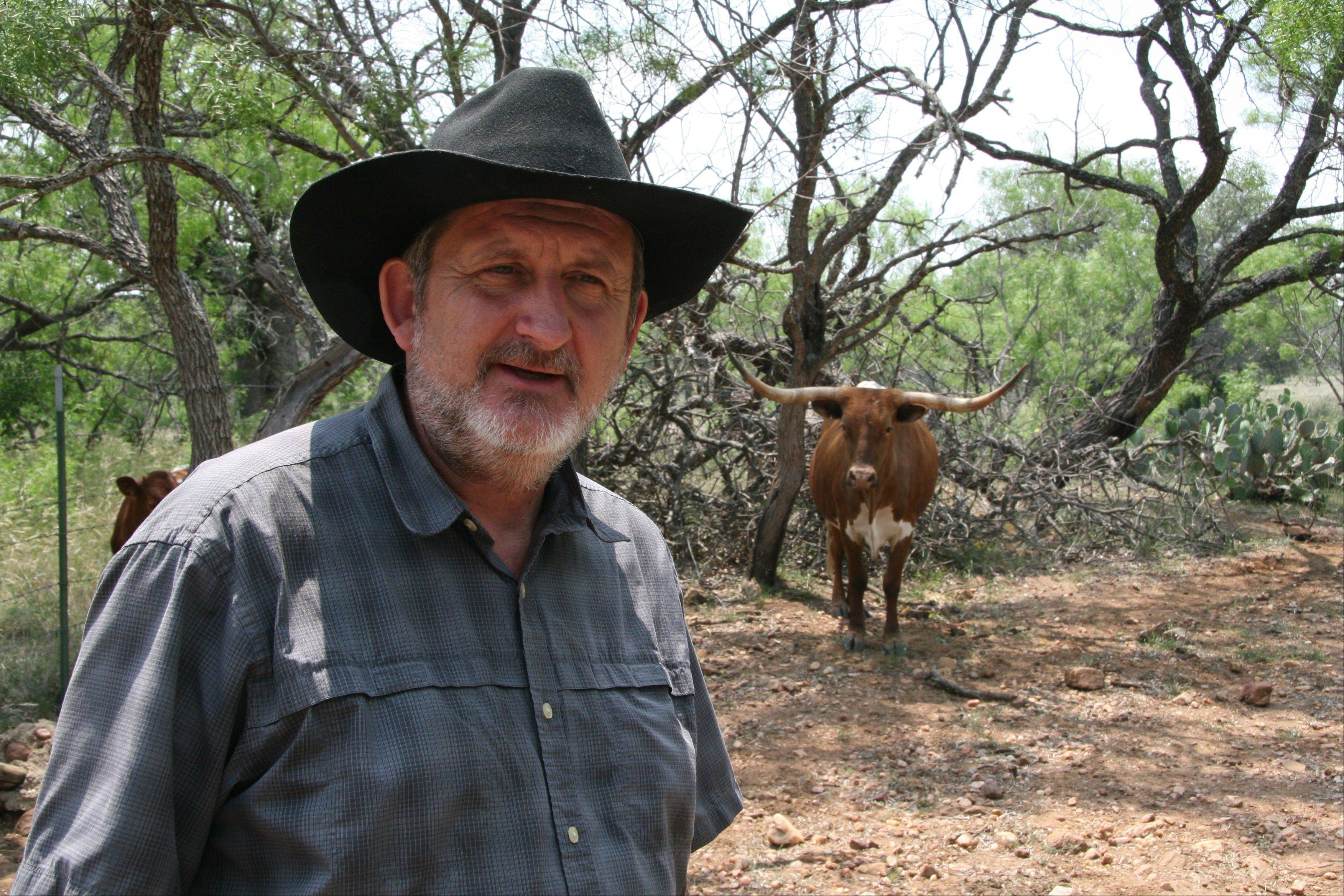 David Hillis, a University of Texas geneticist and biologist, stands at his Double Helix Ranch near Pontotoc, Texas. Research by Hillis and doctoral student Emily Jane McTavish, along with scientists from the University of Missouri-Columbia, also confirms Longhorns are direct descendants of cattle brought by Christopher Columbus in his second voyage to the New World in 1493.